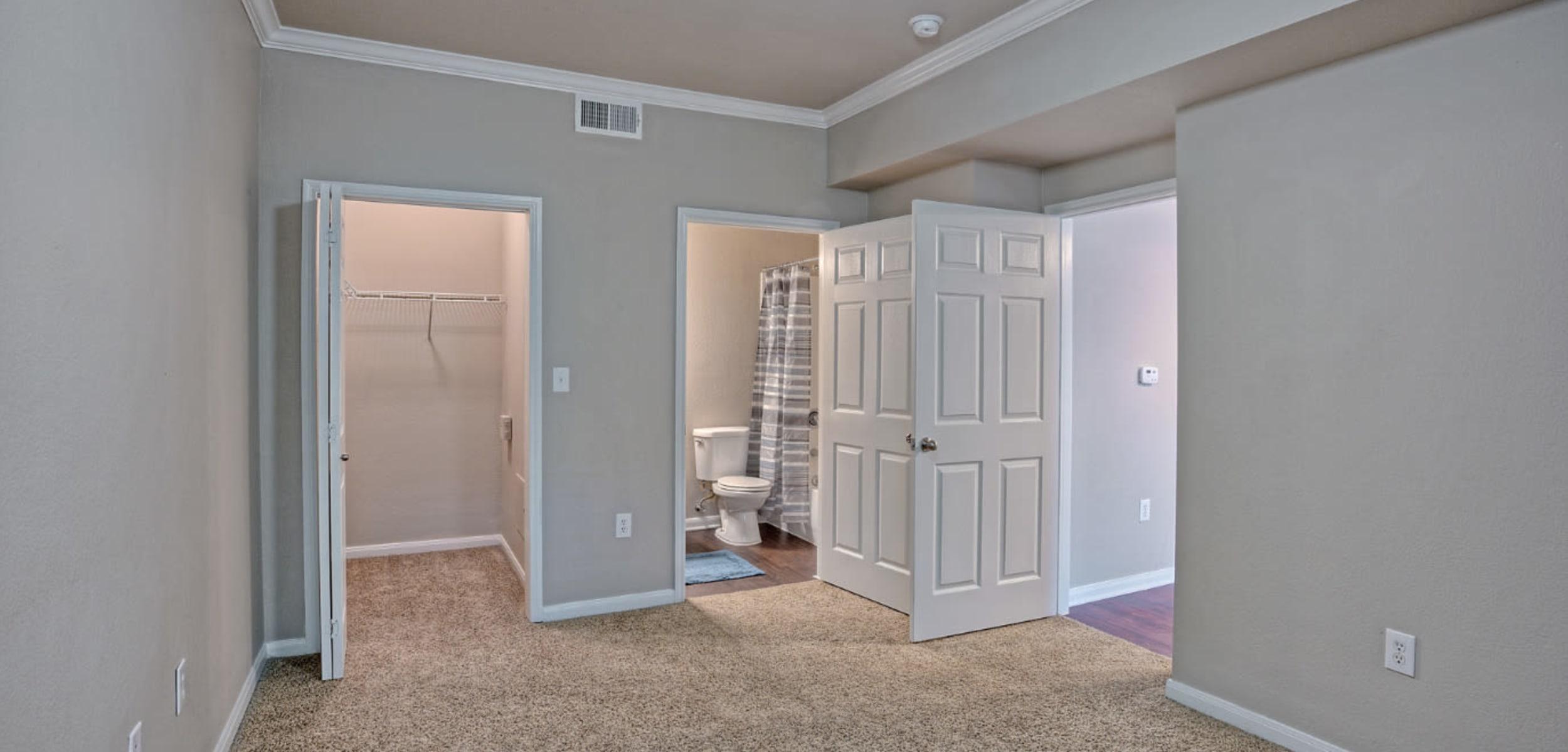 Master bedroom with walk-in closet and bathroom at Marquis Bandera in San Antonio, Texas