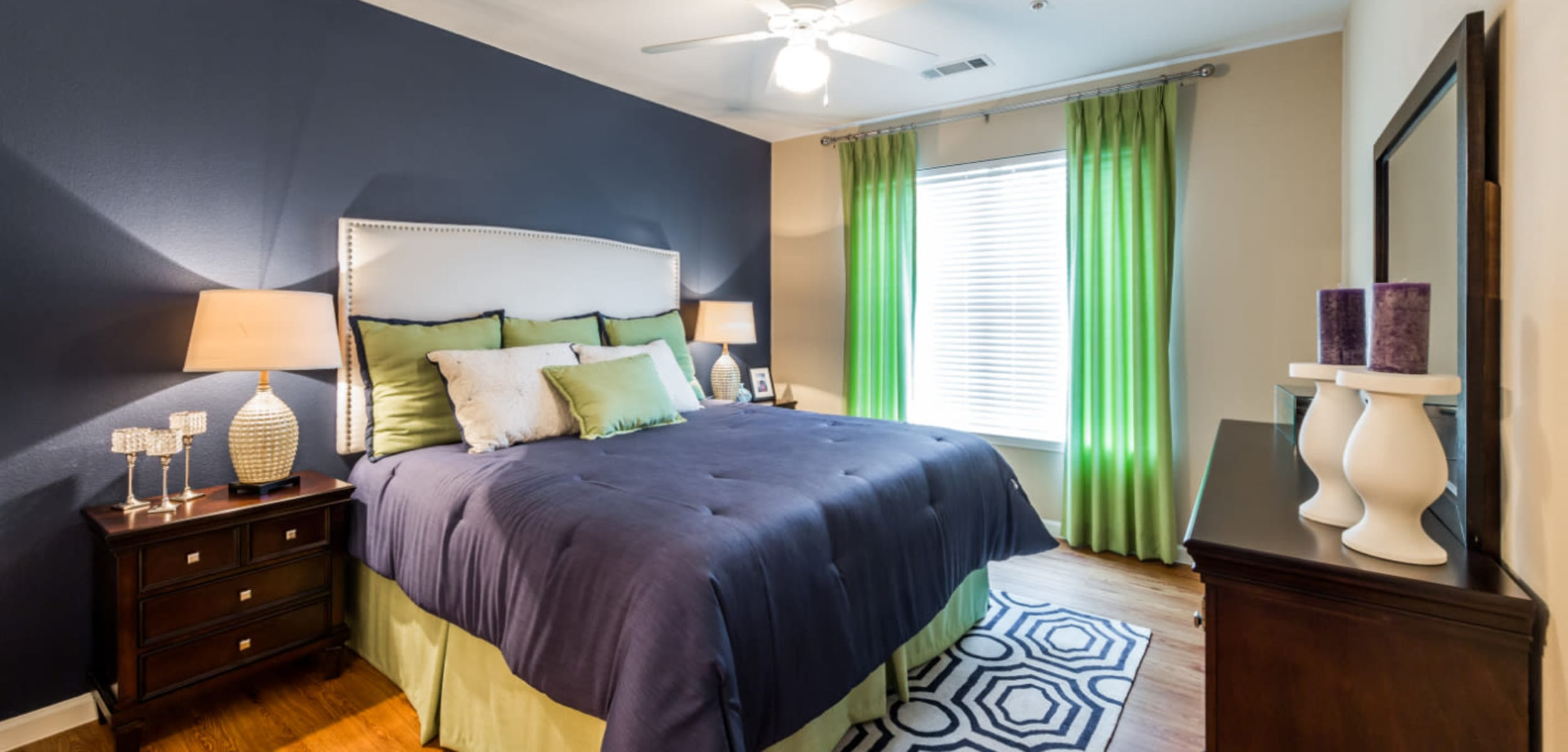 Bedroom with a large window at Marquis at Canyon Ridge in Austin, Texas