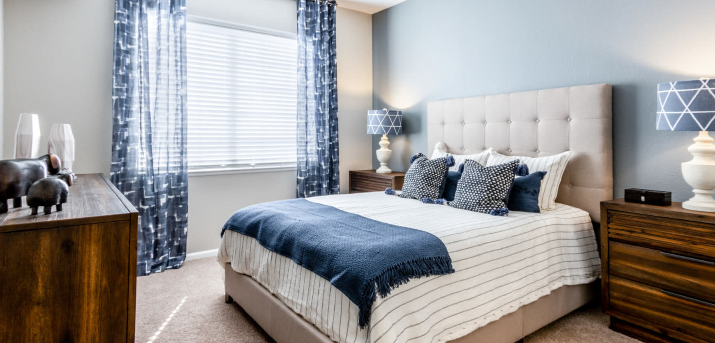 Bedroom with a large window at The Links at Plum Creek in Castle Rock, Colorado