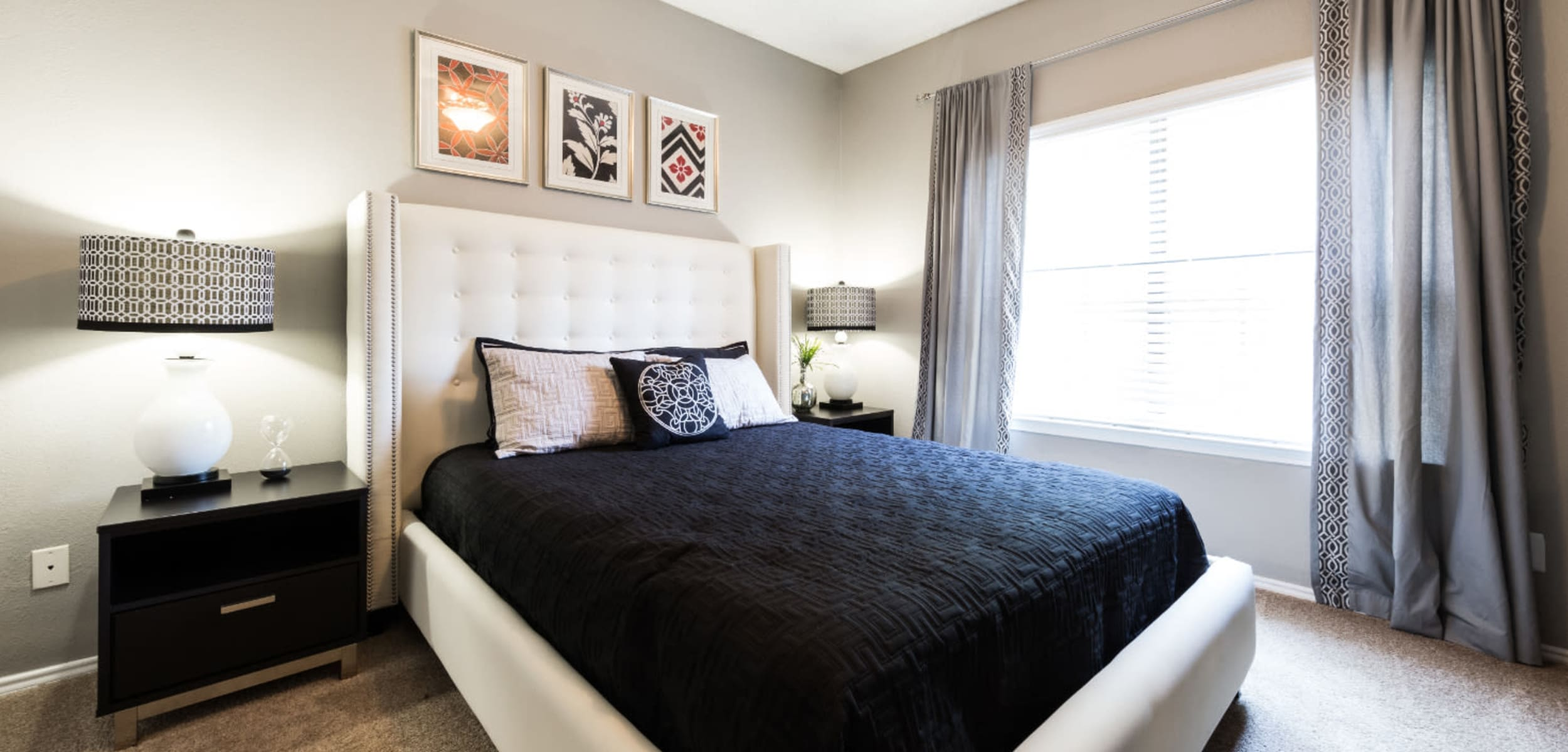 Bedroom with a large window at Marquis at Legacy in Plano, Texas