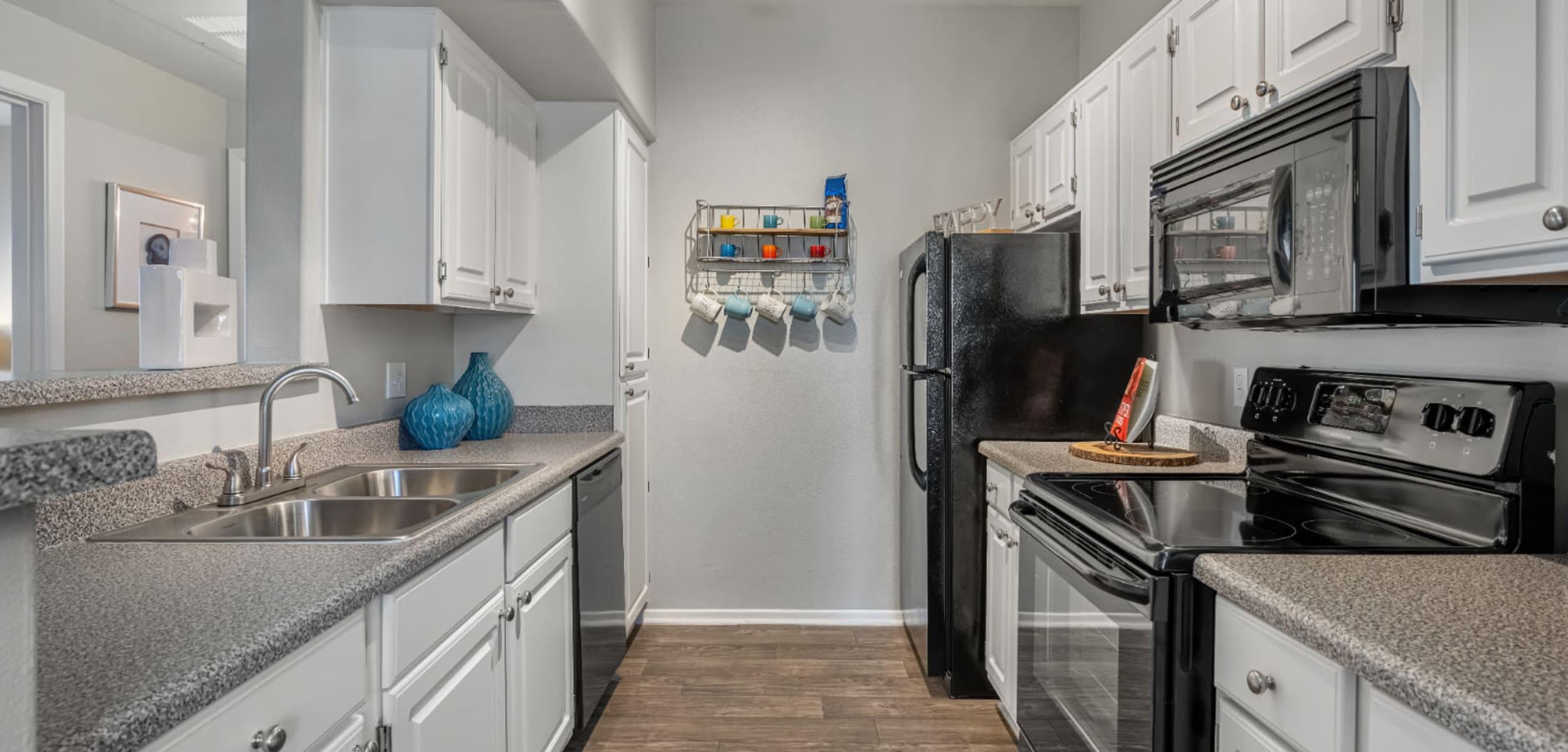 Modern, sleek kitchen with modern appliances at Alante at the Islands in Chandler, Arizona