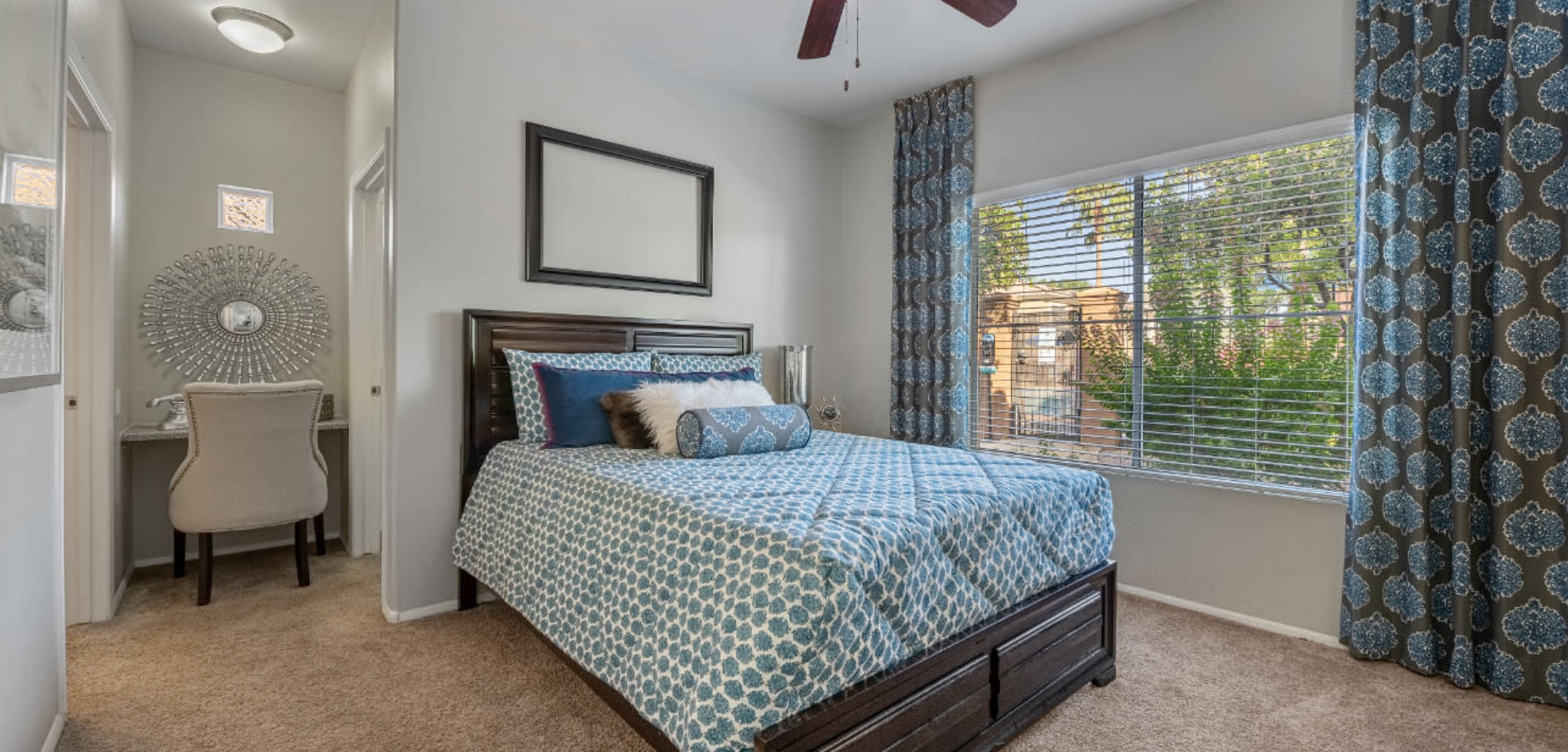 Bedroom with a large window and seating area at Alante at the Islands in Chandler, Arizona