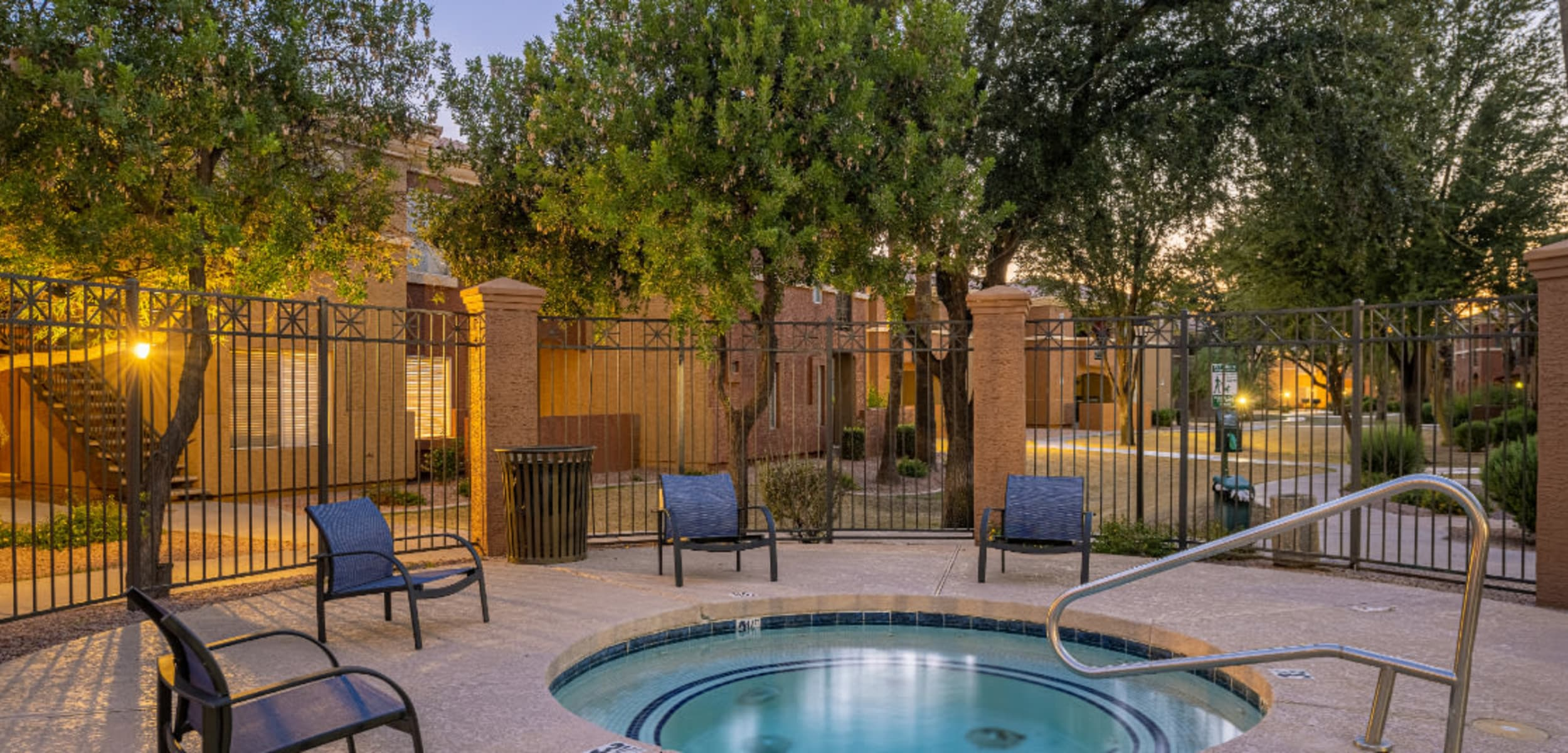 Enclosed hot tub area with cushioned chairs at Alante at the Islands in Chandler, Arizona