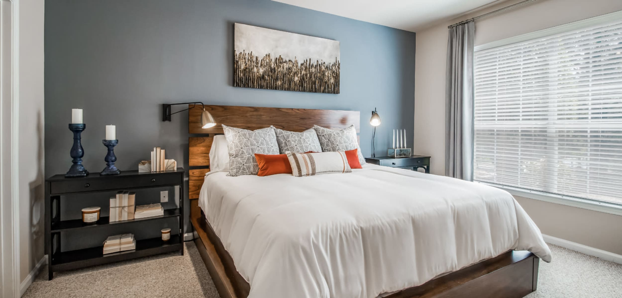 Carpeted bedroom with big window at Marquis at Carmel Commons in Charlotte, North Carolina