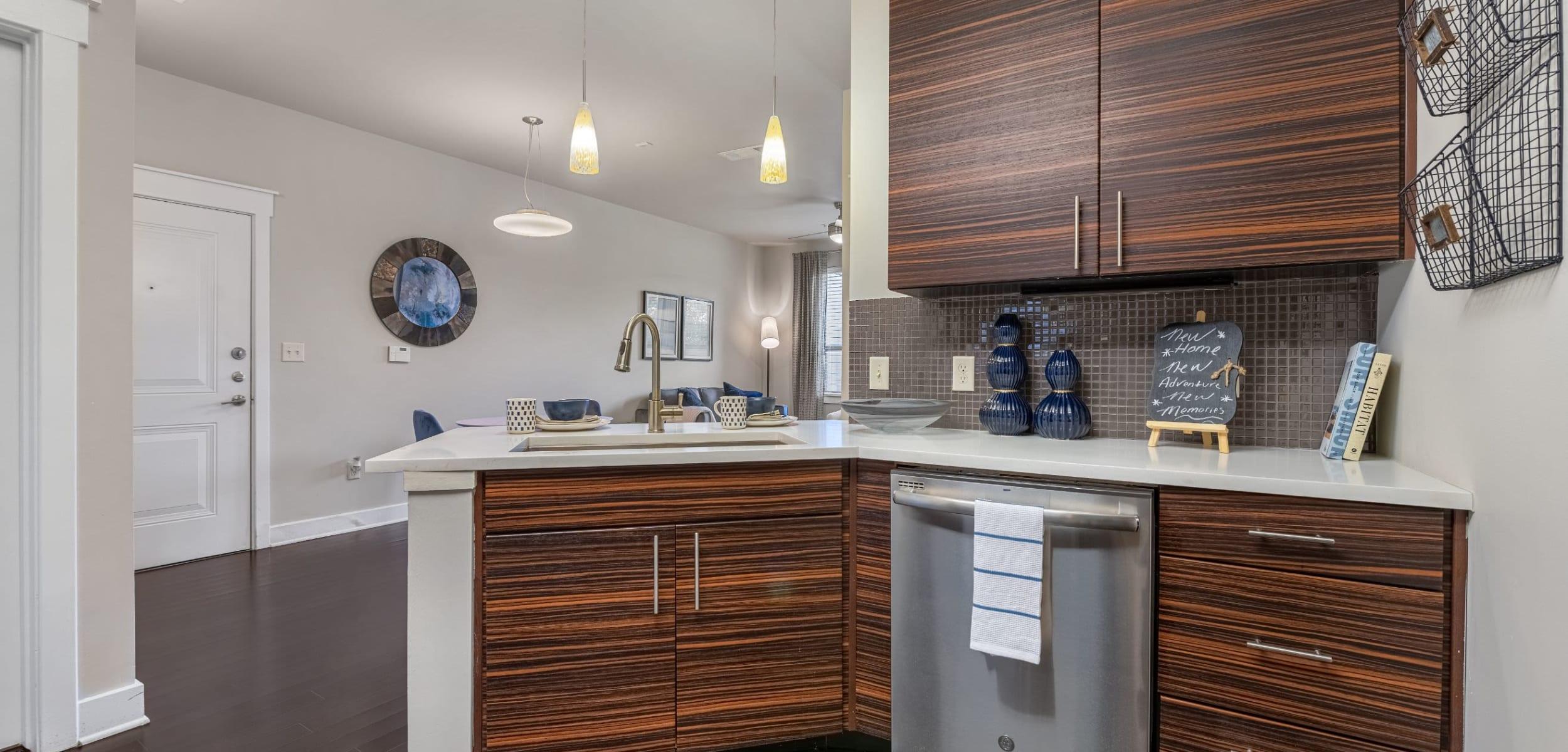 Modern kitchen with a breakfst bar at Marquis Cresta Bella in San Antonio, Texas