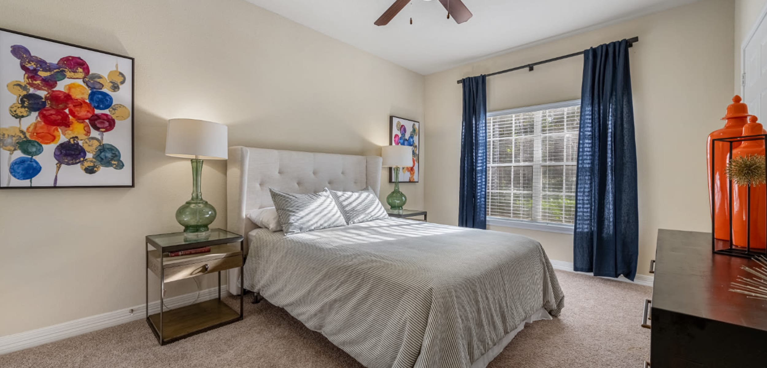 Carpeted spacious bedroom with big window at Marquis at Kingwood in Kingwood, Texas