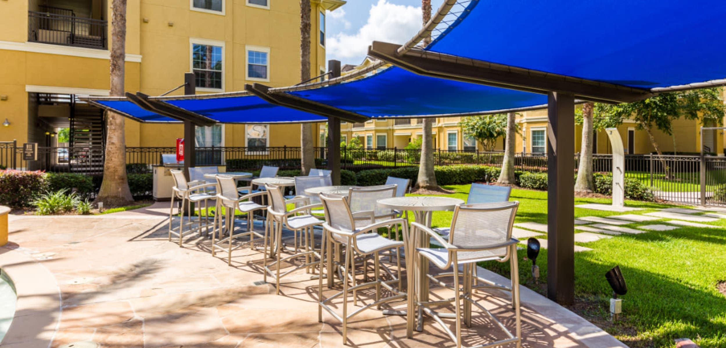 Shaded dining chairs and tables at Marquis at Clear Lake in Webster, Texas