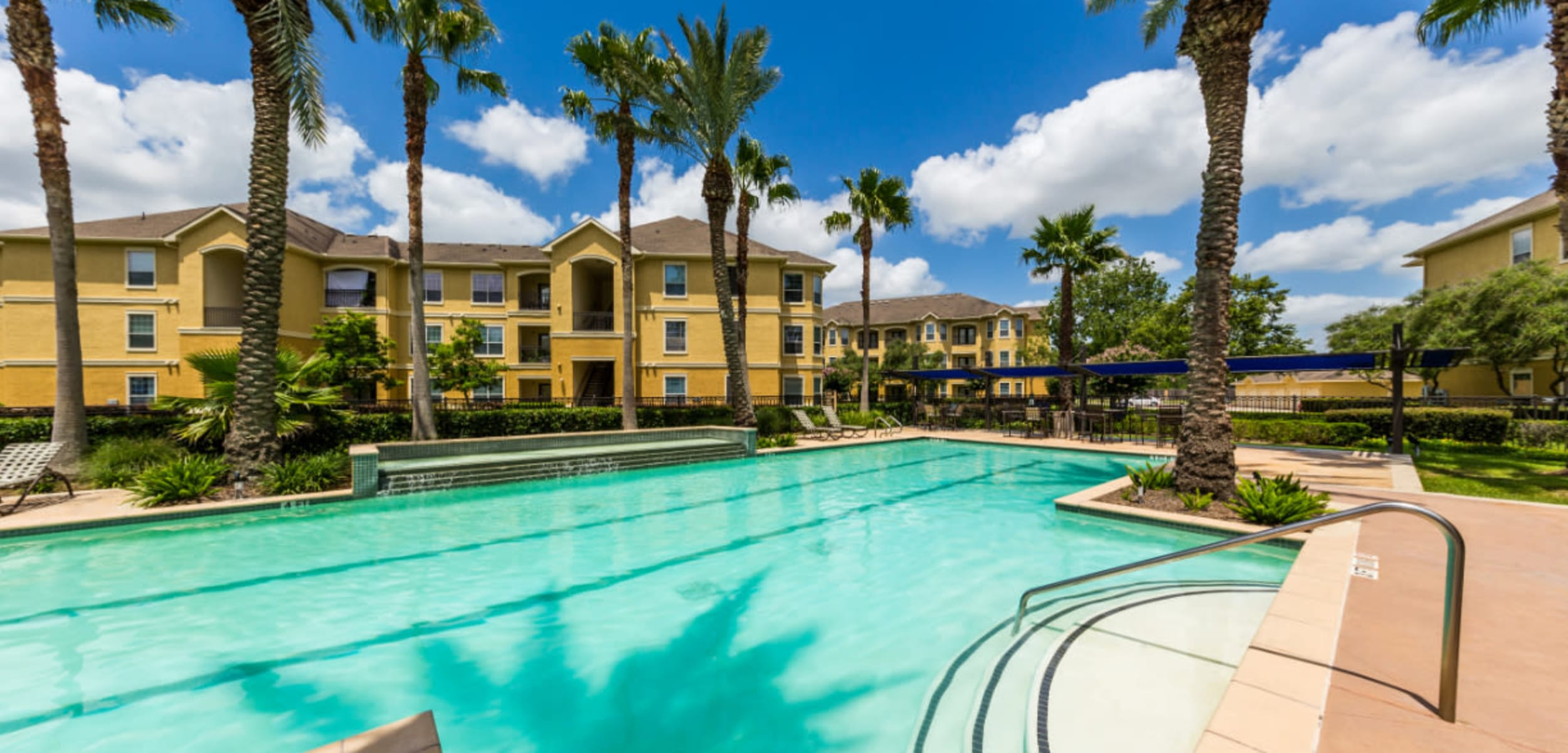Resort style pool with water features at Marquis at Clear Lake in Webster Texas,