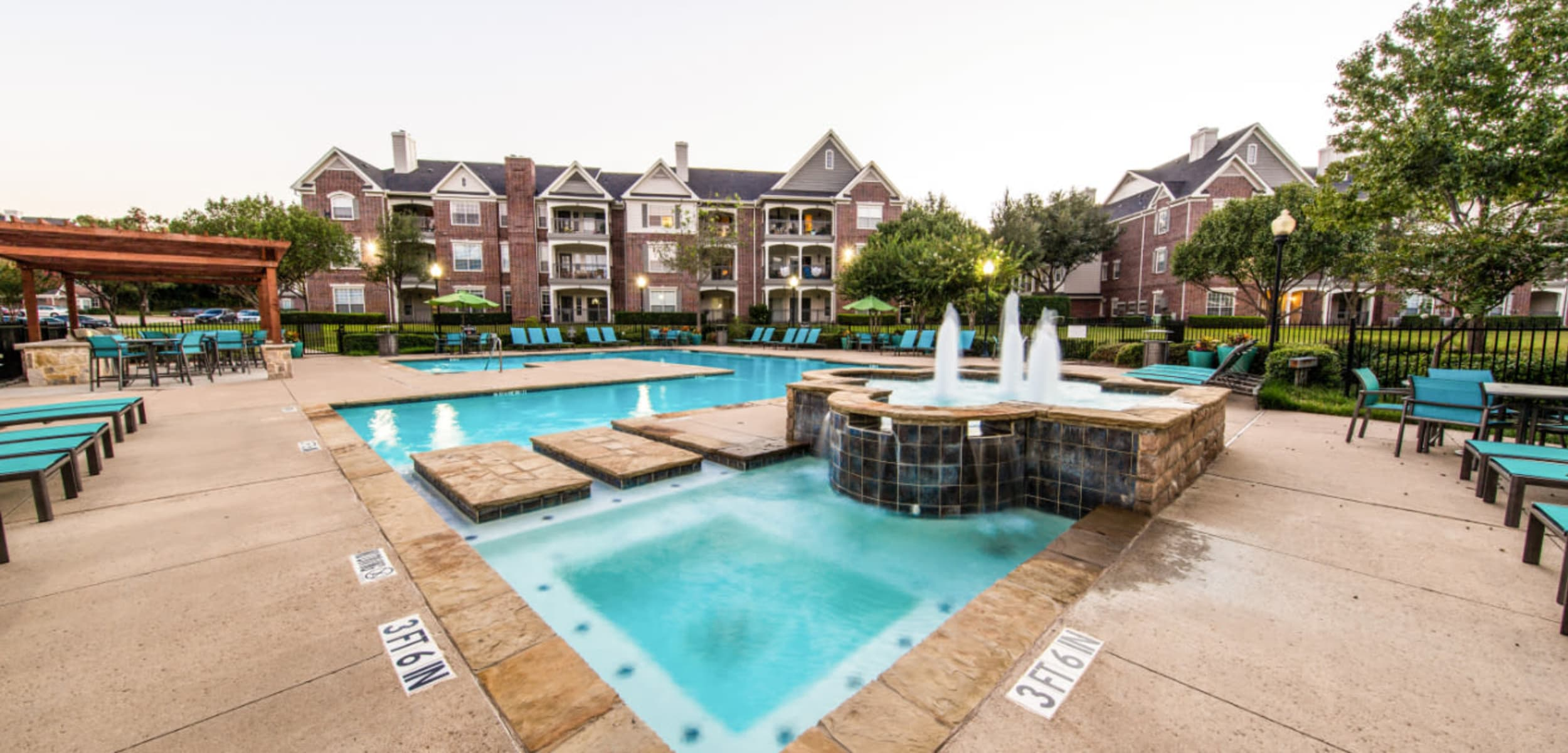 Pool deck and hot tub area with water features at Marquis at Silver Oaks in Grapevine Texas,