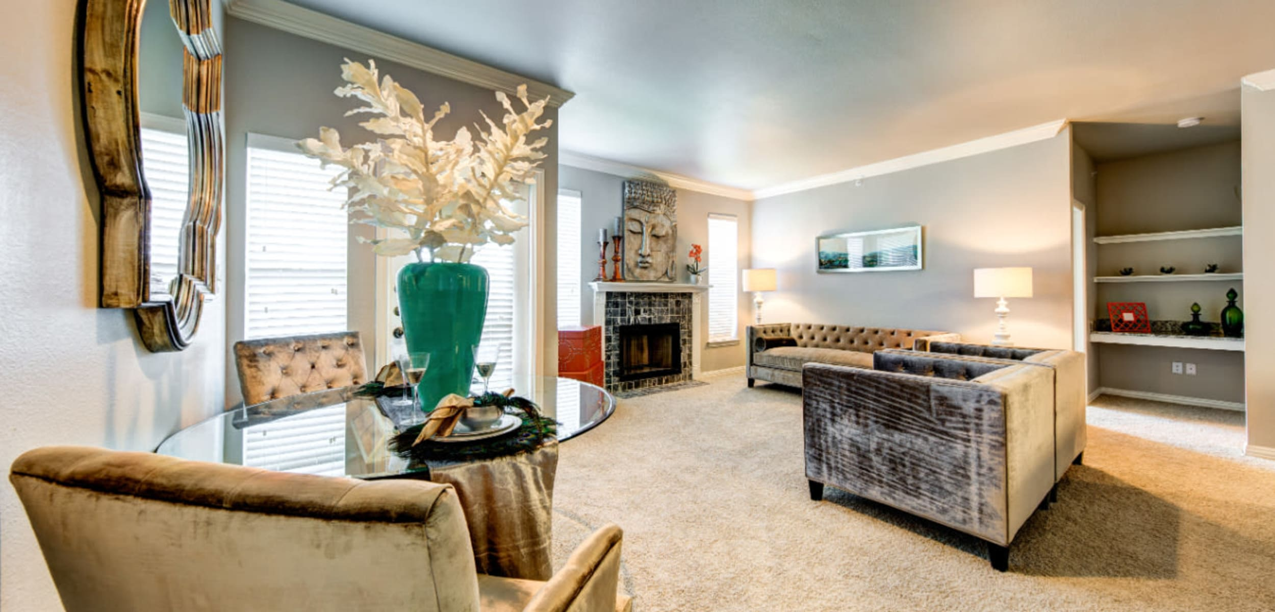 Modern style living room with sitting chairs, dining area, and built-in shelves at Marquis at Silver Oaks in Grapevine, Texas