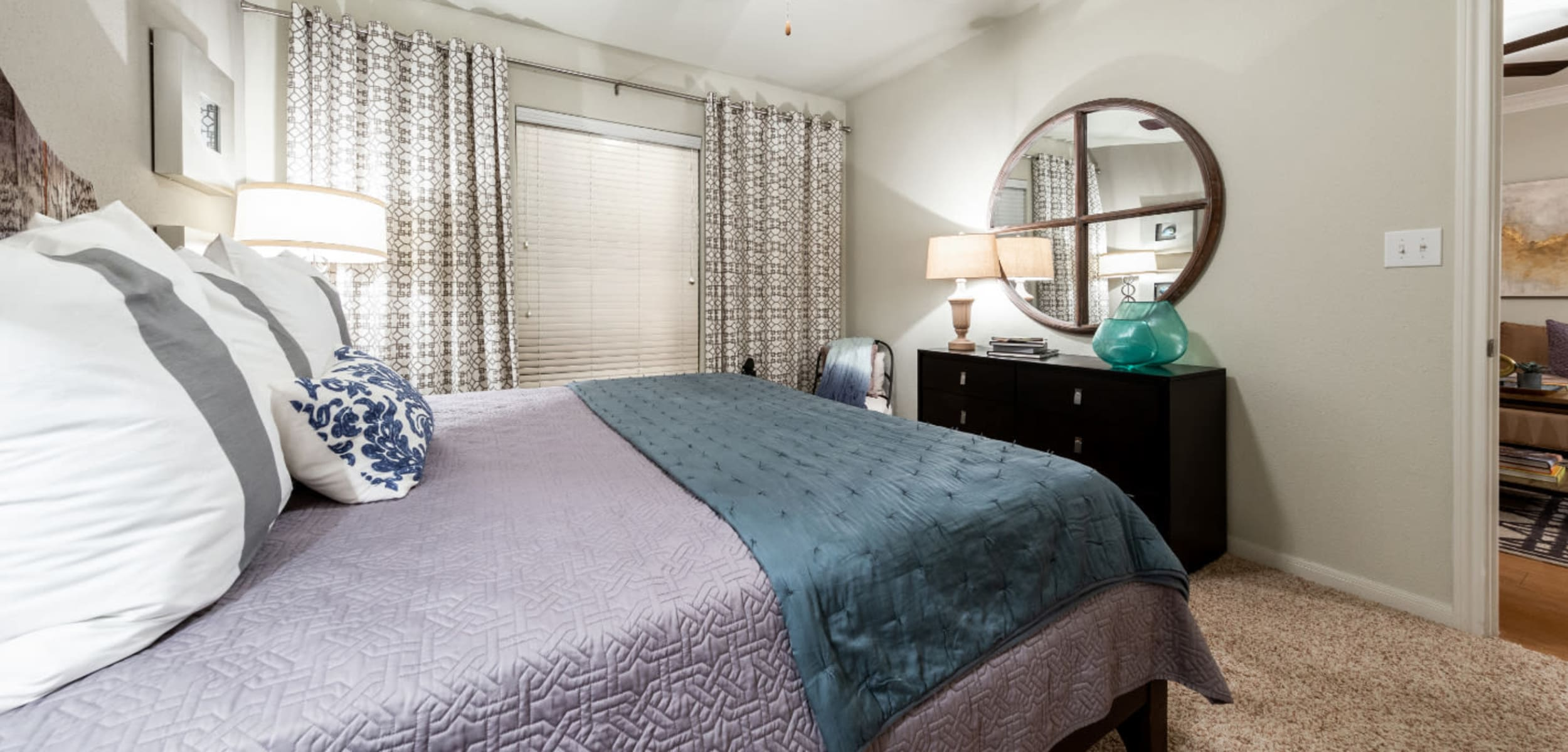 Carpeted bedroom with window at Marquis at the Reserve in Katy, Texas