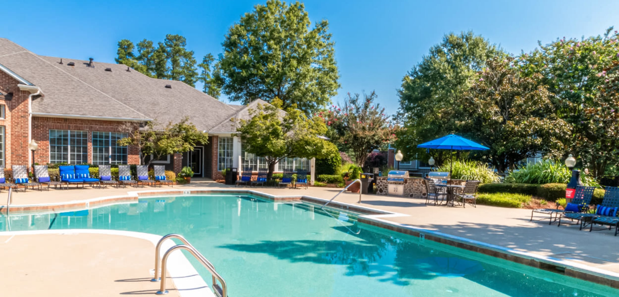 Deep end of pool in front of clubhouse at Marquis of Carmel Valley in Charlotte North Carolina,