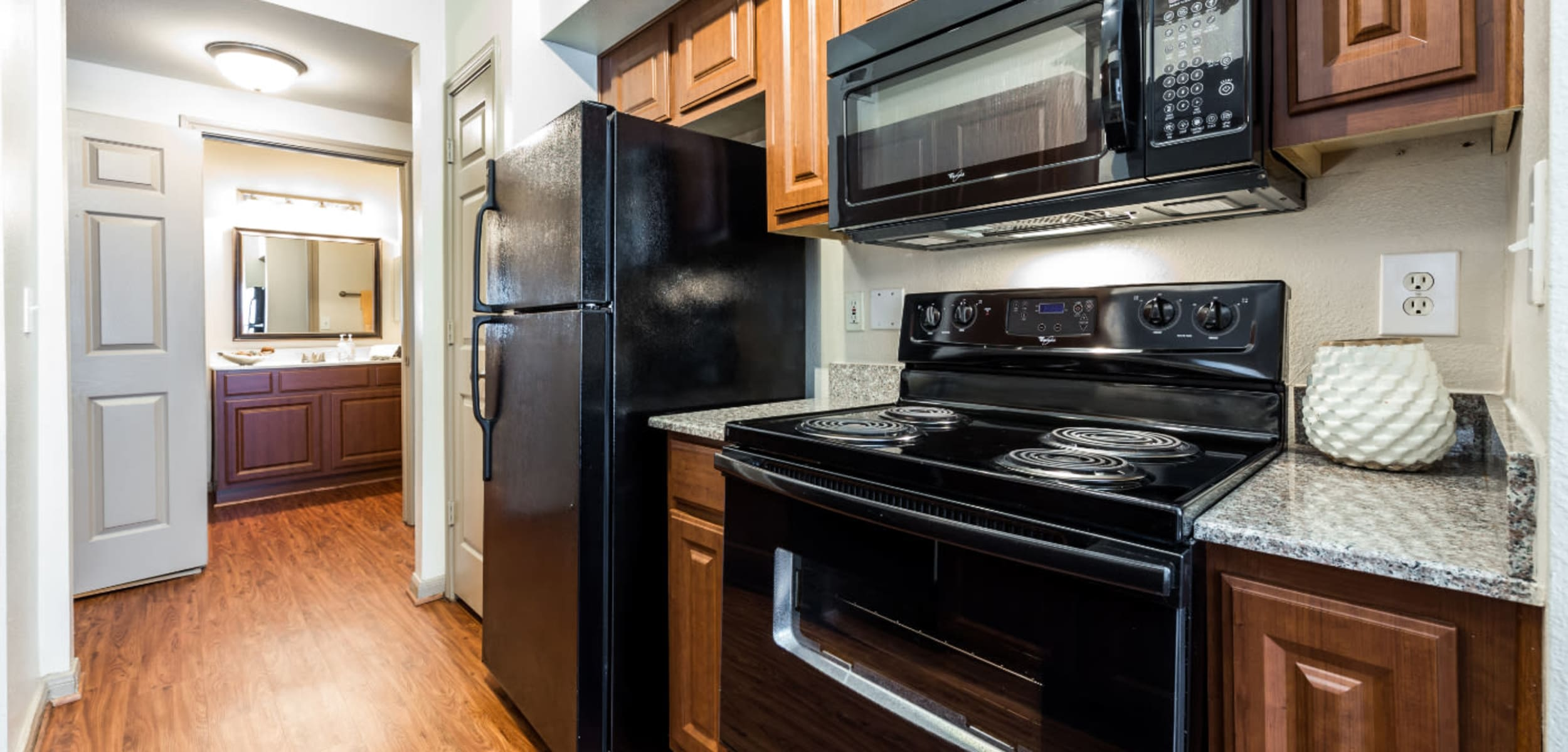 Pass through area of kitchen towards bathroom at Marquis on Park Row in Houston, Texas