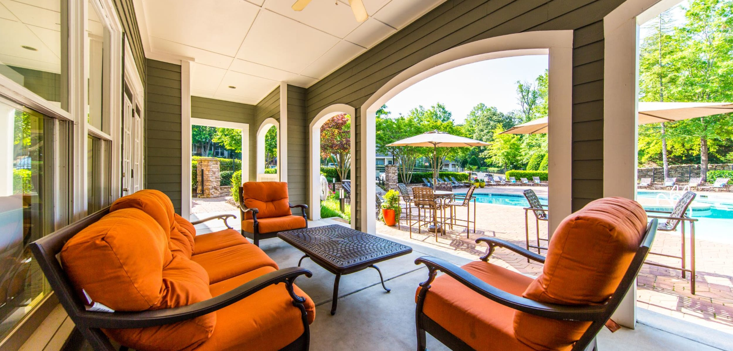 Bright outdoor seating area near the pool at Marquis on Edwards Mill in Raleigh, North Carolina