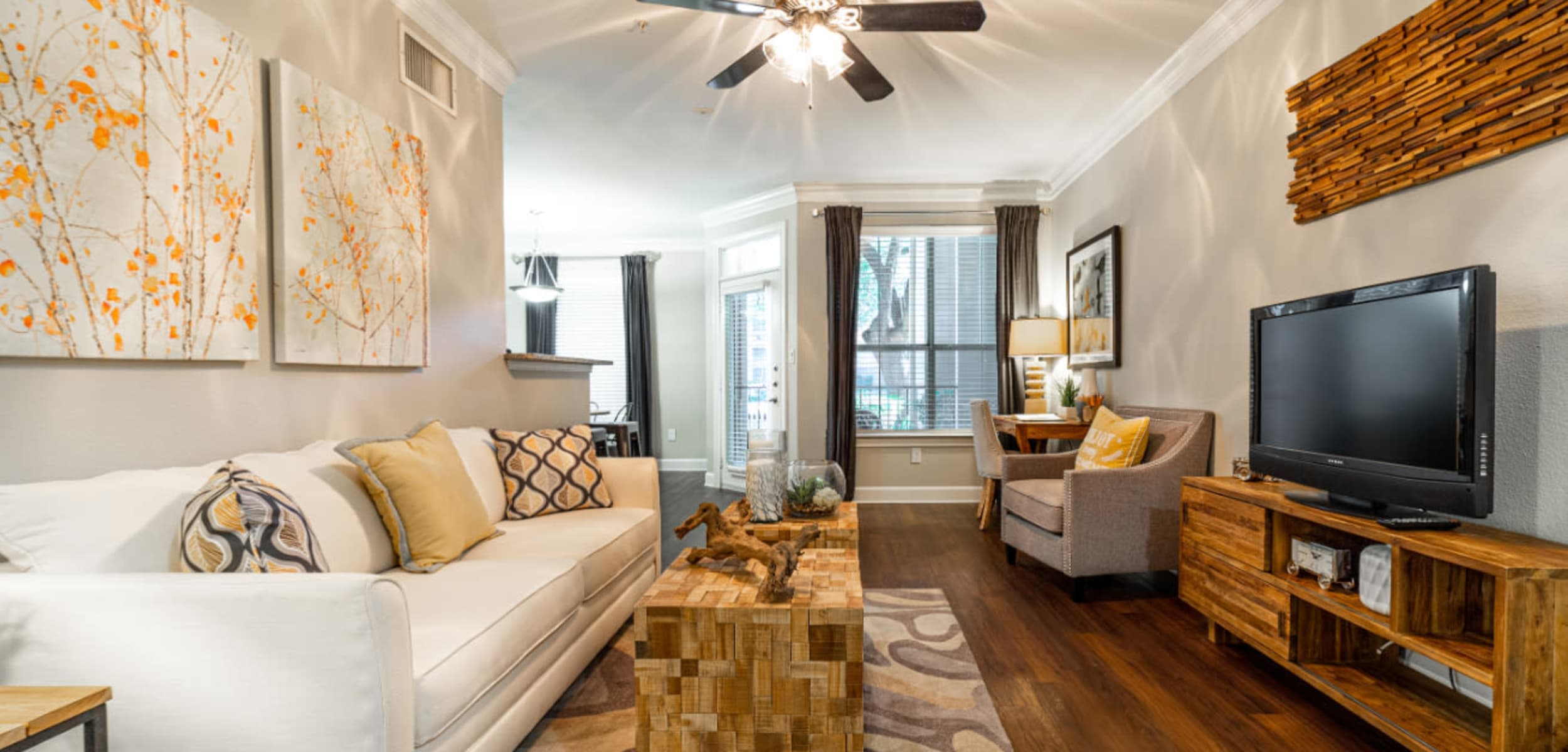Modern style living room with wood flooring at Marquis at Great Hills in Austin Texas,