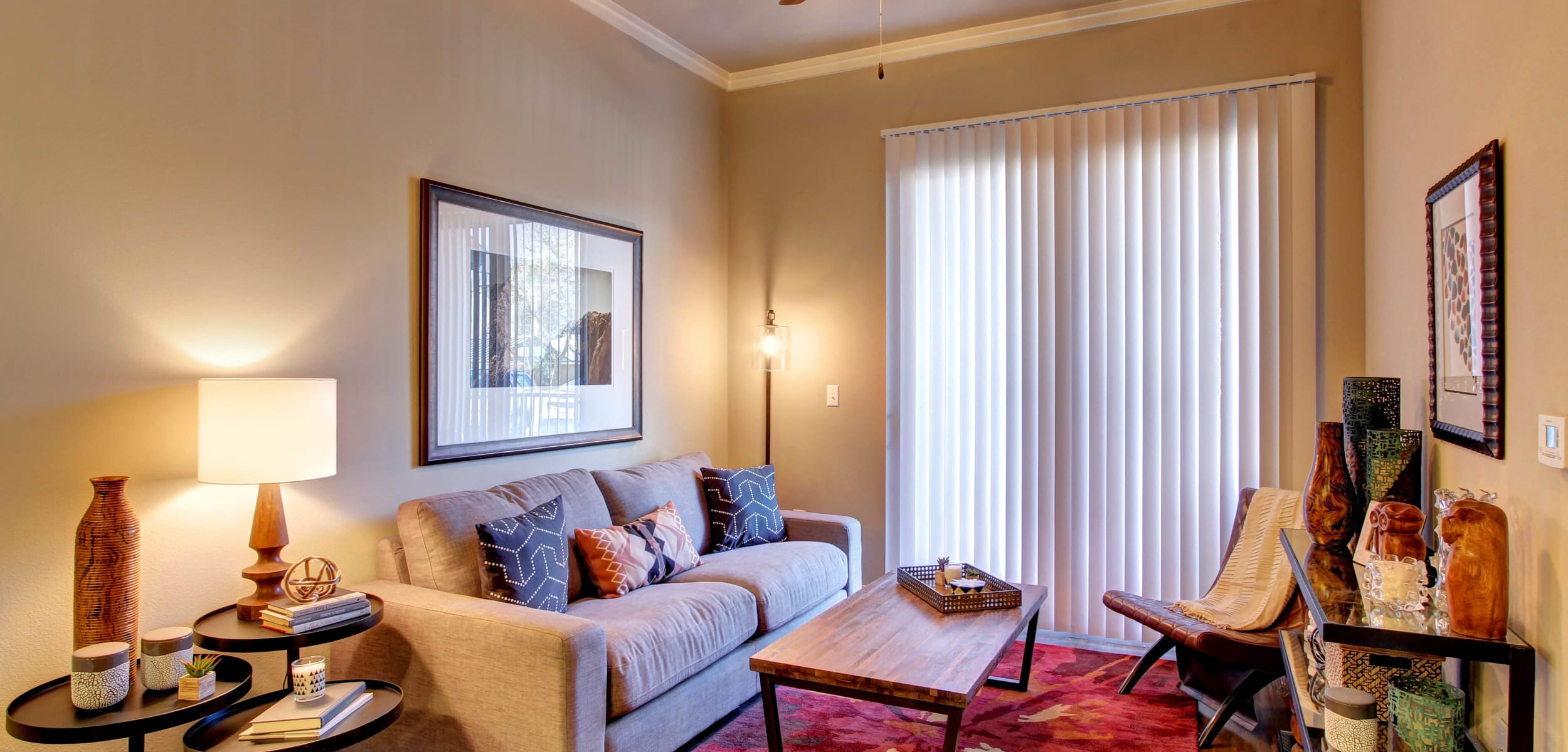 Open living room floor plan with wood flooring at Marquis at Barton Trails in Austin, Texas