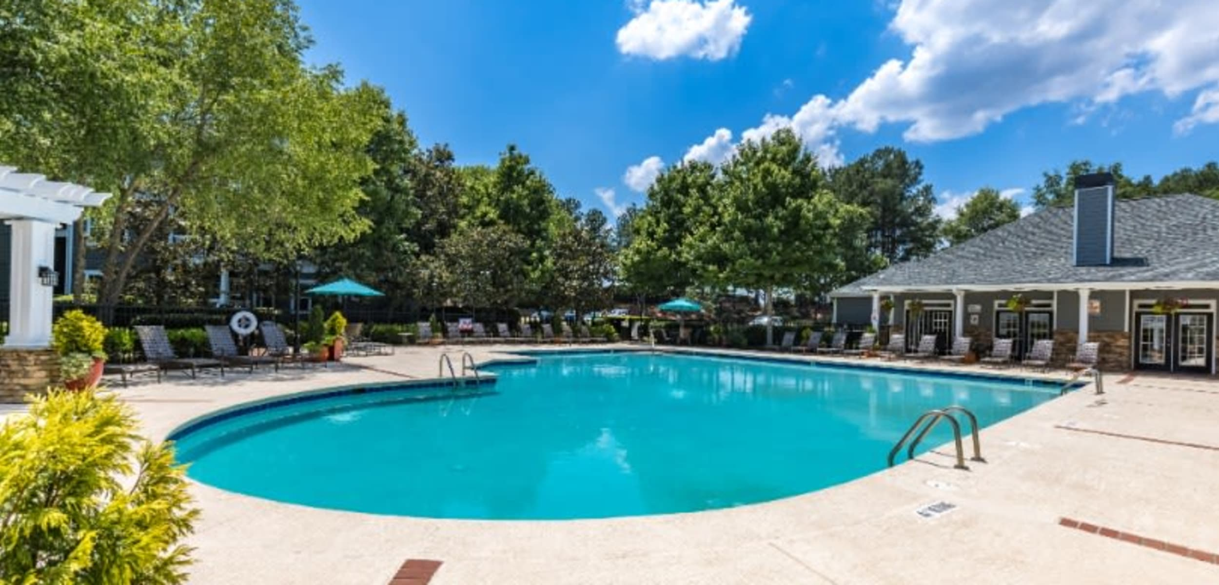 Lounge chairs lined up next to pool at Marquis on Cary Parkway in Morrisville North Carolina,