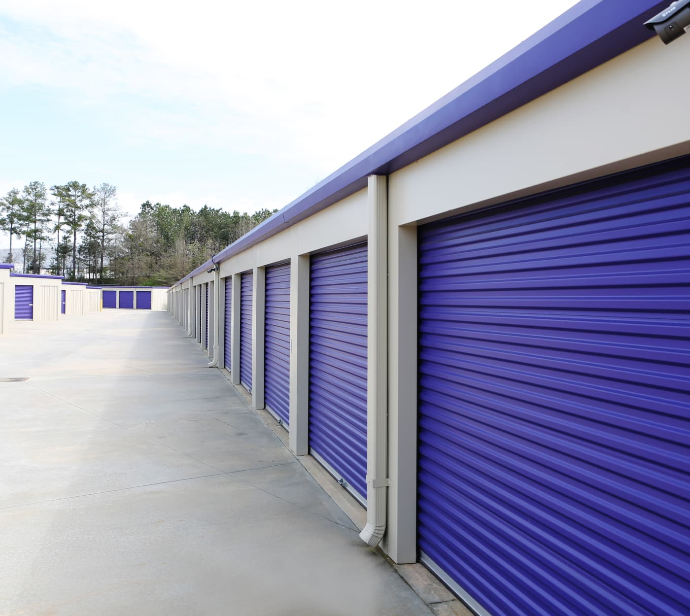 Units with blu roll-up doors at StoreSmart Self-Storage in McDonough, Georgia