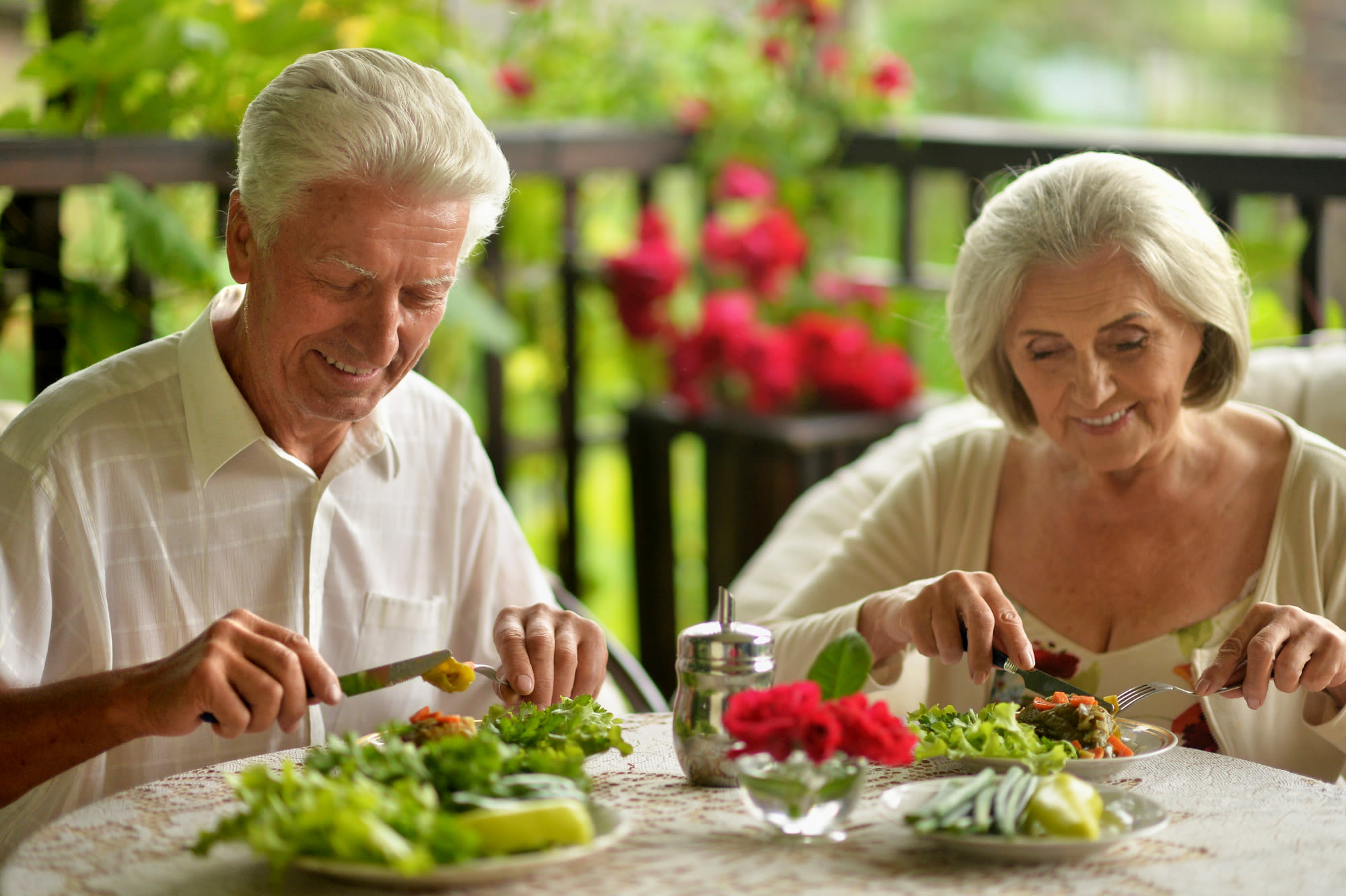 Resident couple eating a chef-prepared diner at The Iris Senior Living in Great Falls, Montana