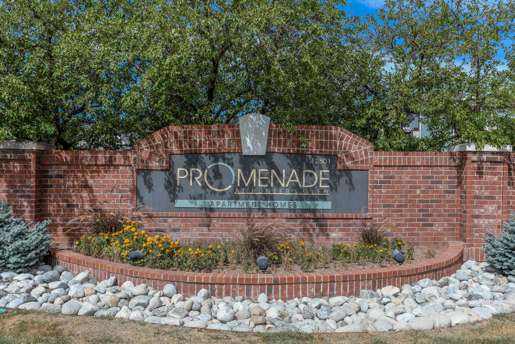 Monument sign to Promenade at Hunter's Glen Apartments