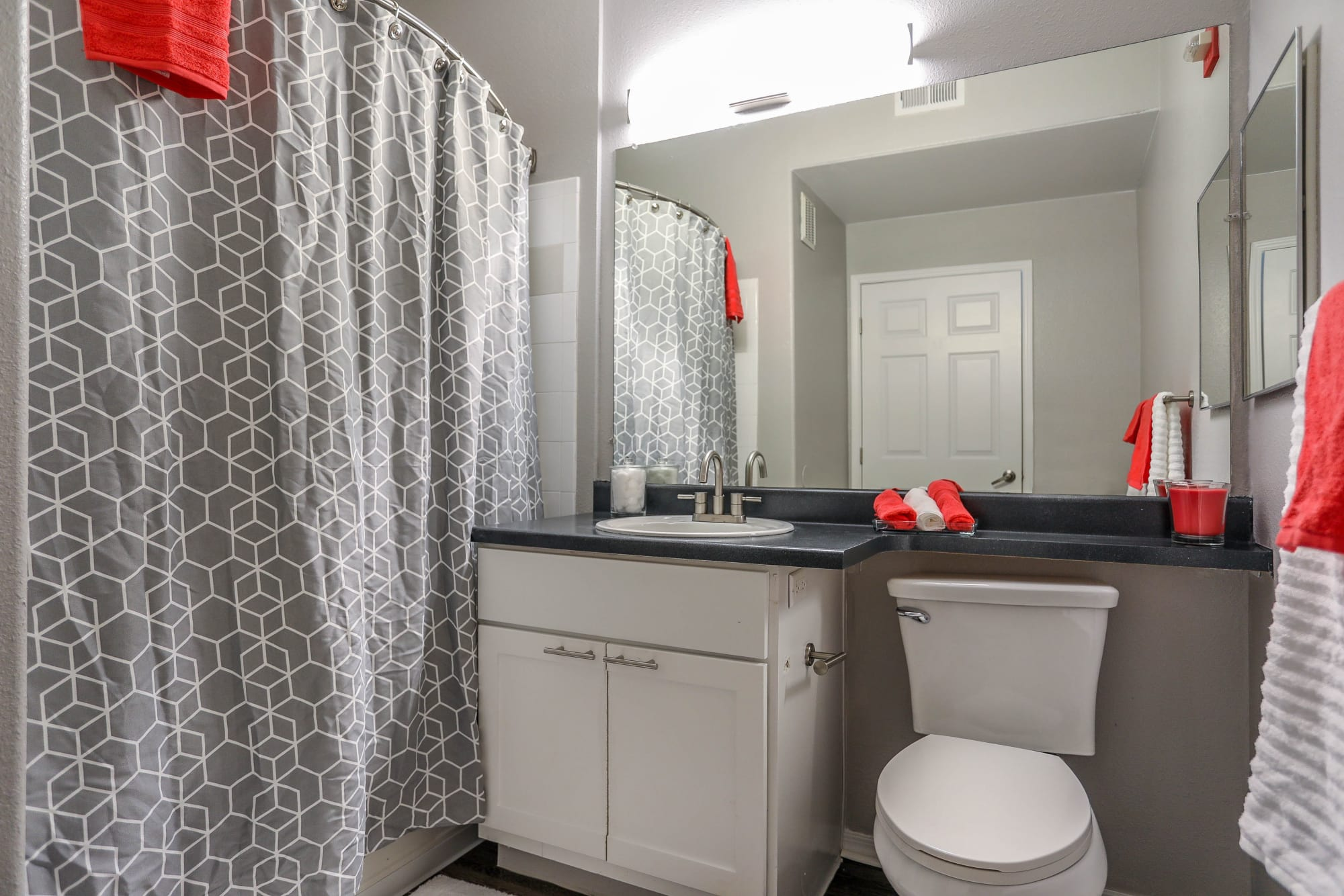 White cabinetry in a bathroom at Promenade at Hunter's Glen Apartments in Thornton, Colorado