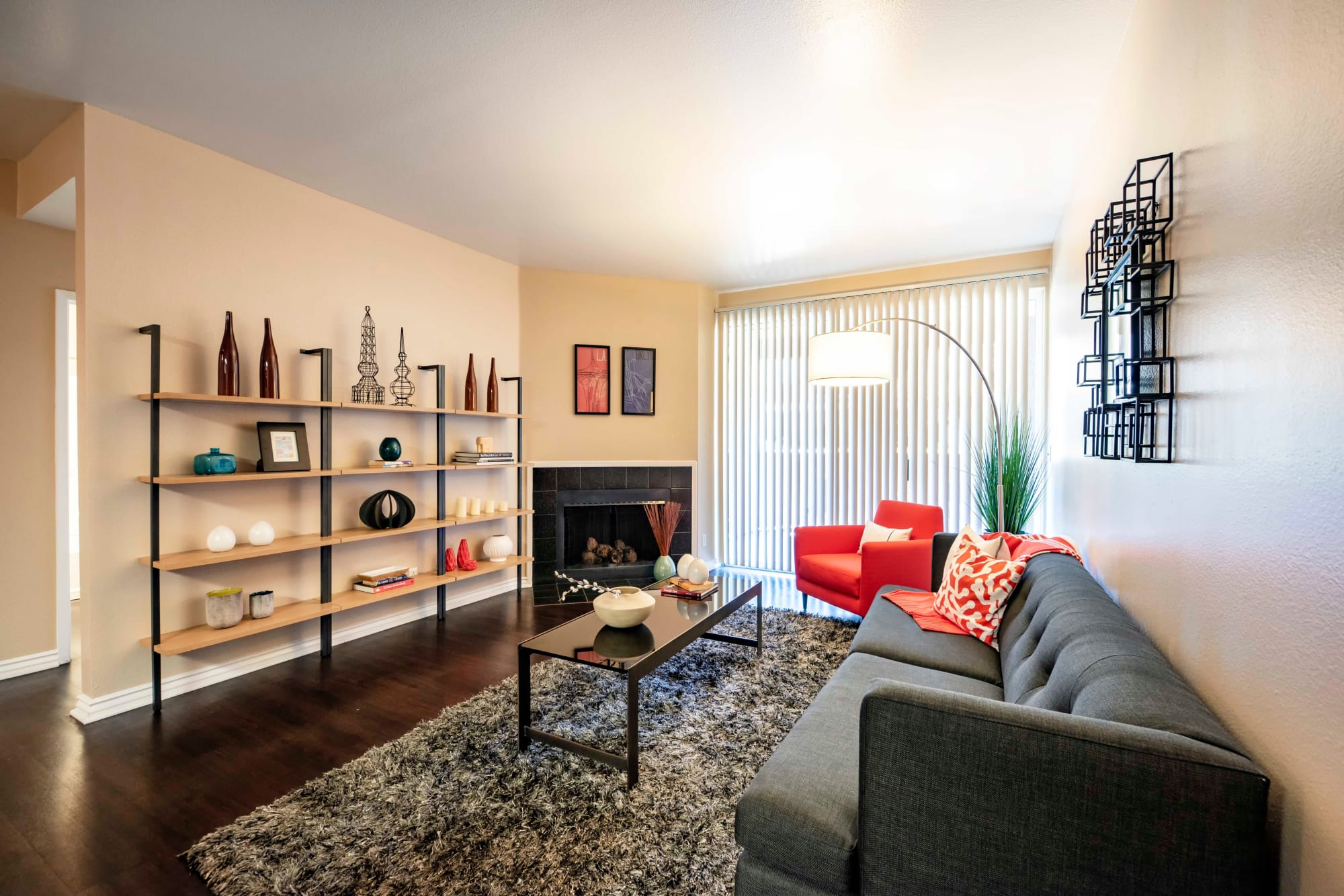 Open Living Room Area Furnished with Fireplace