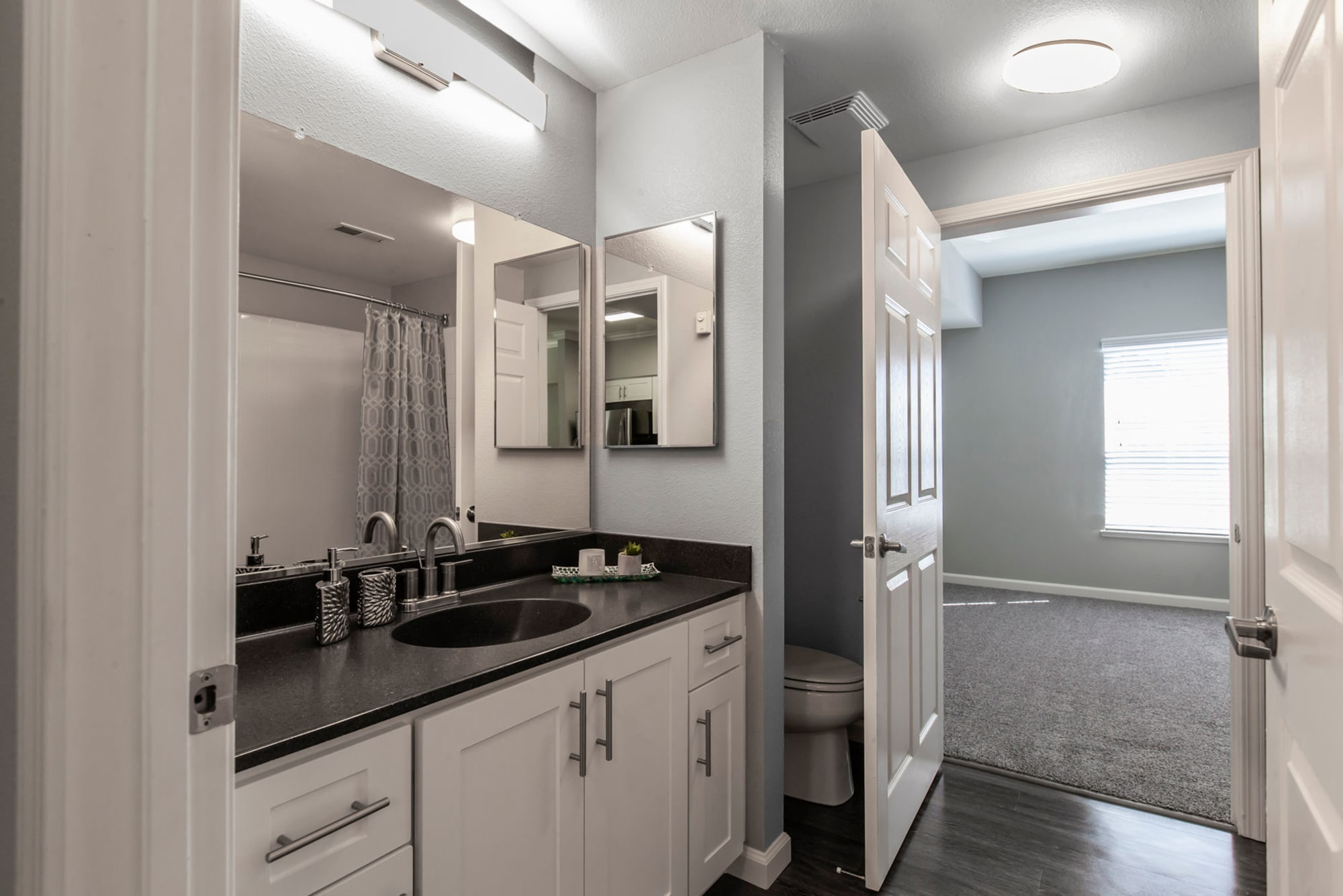 White bathroom renovation  at Hawthorn Village Apartments