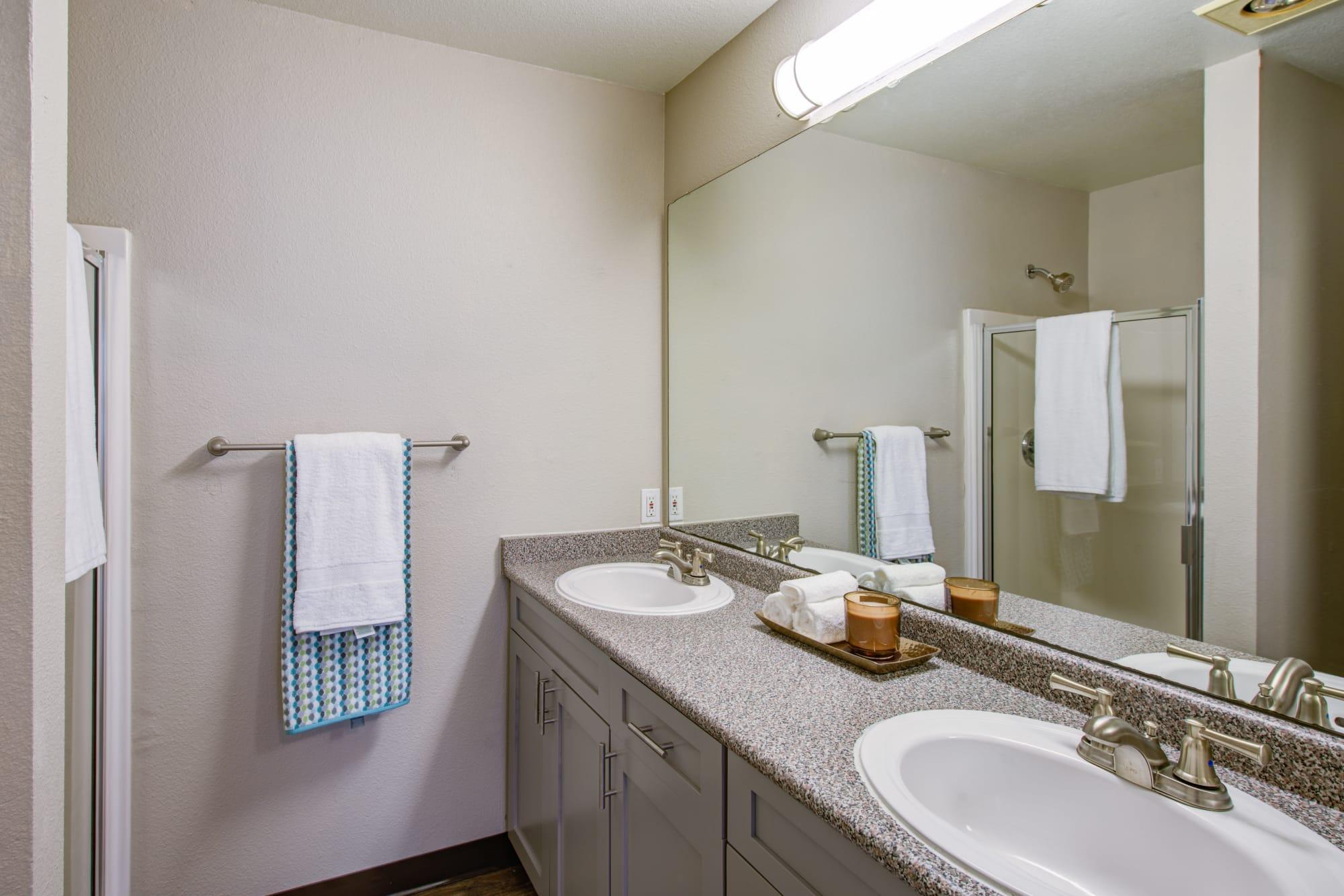 model bathroom withgrey cabinetry