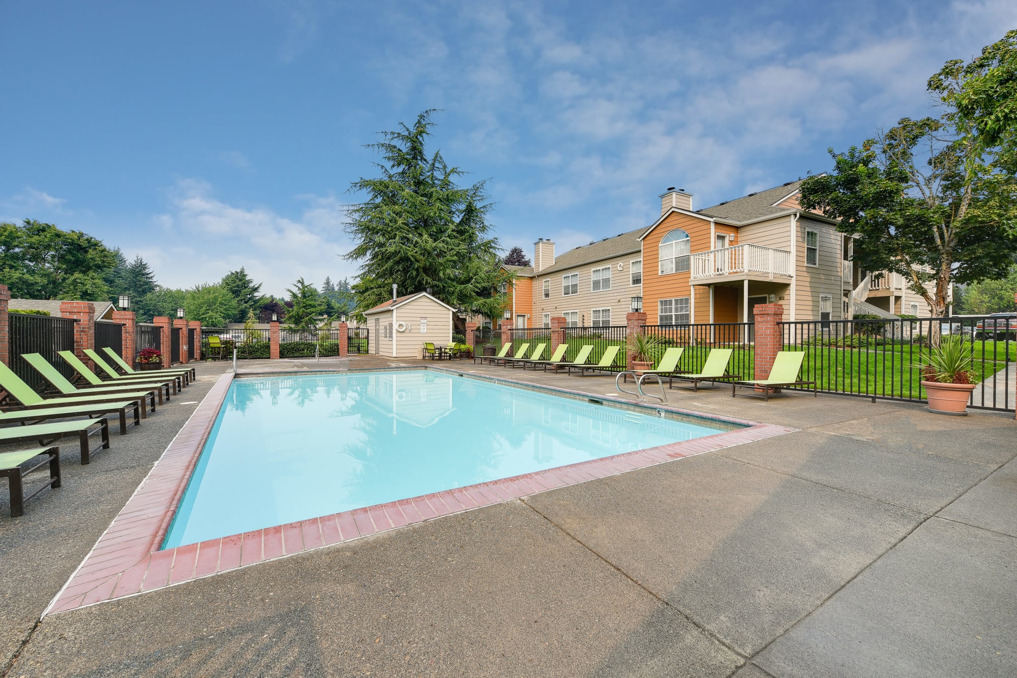 Lounge chairs by the pool at Carriage Park Apartments in Vancouver, Washington