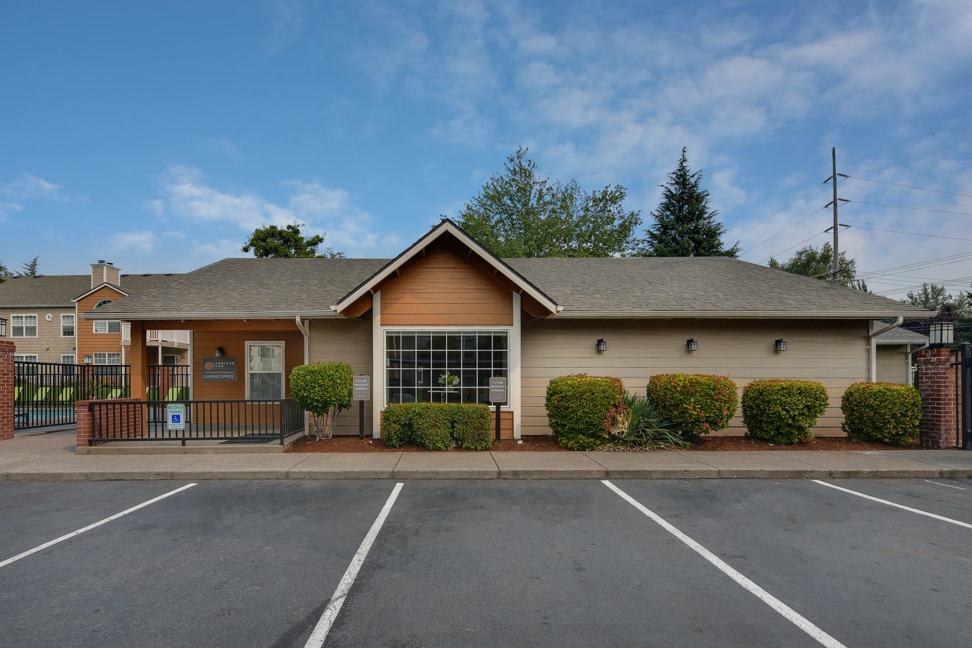 The front exterior of the leasing office at Carriage Park Apartments in Vancouver, Washington
