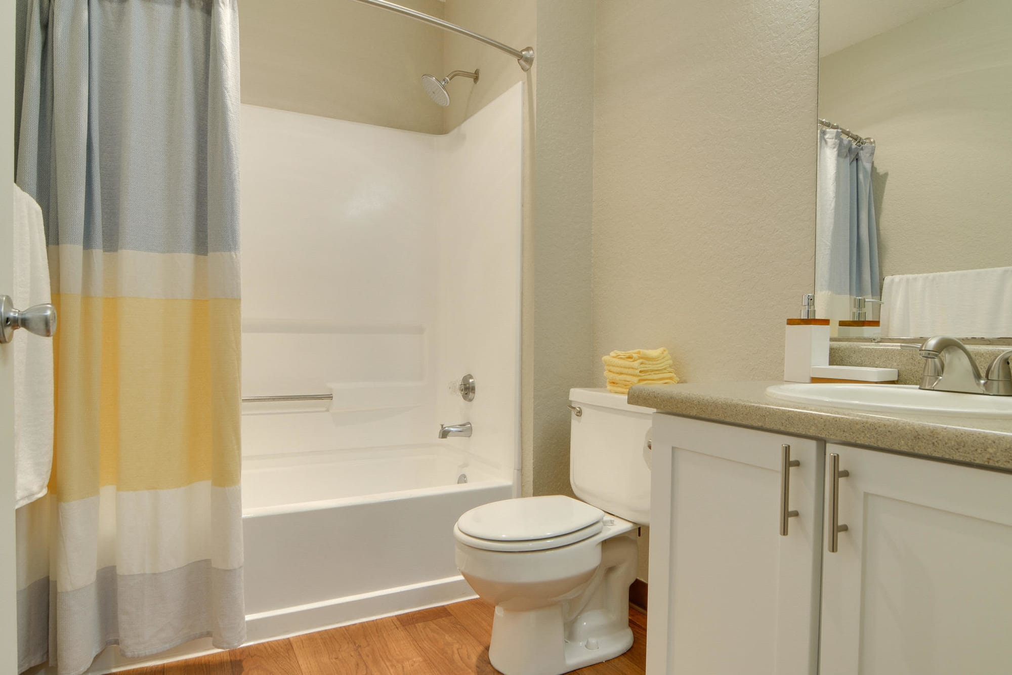 Neat bathroom with tub at Carriage Park Apartments