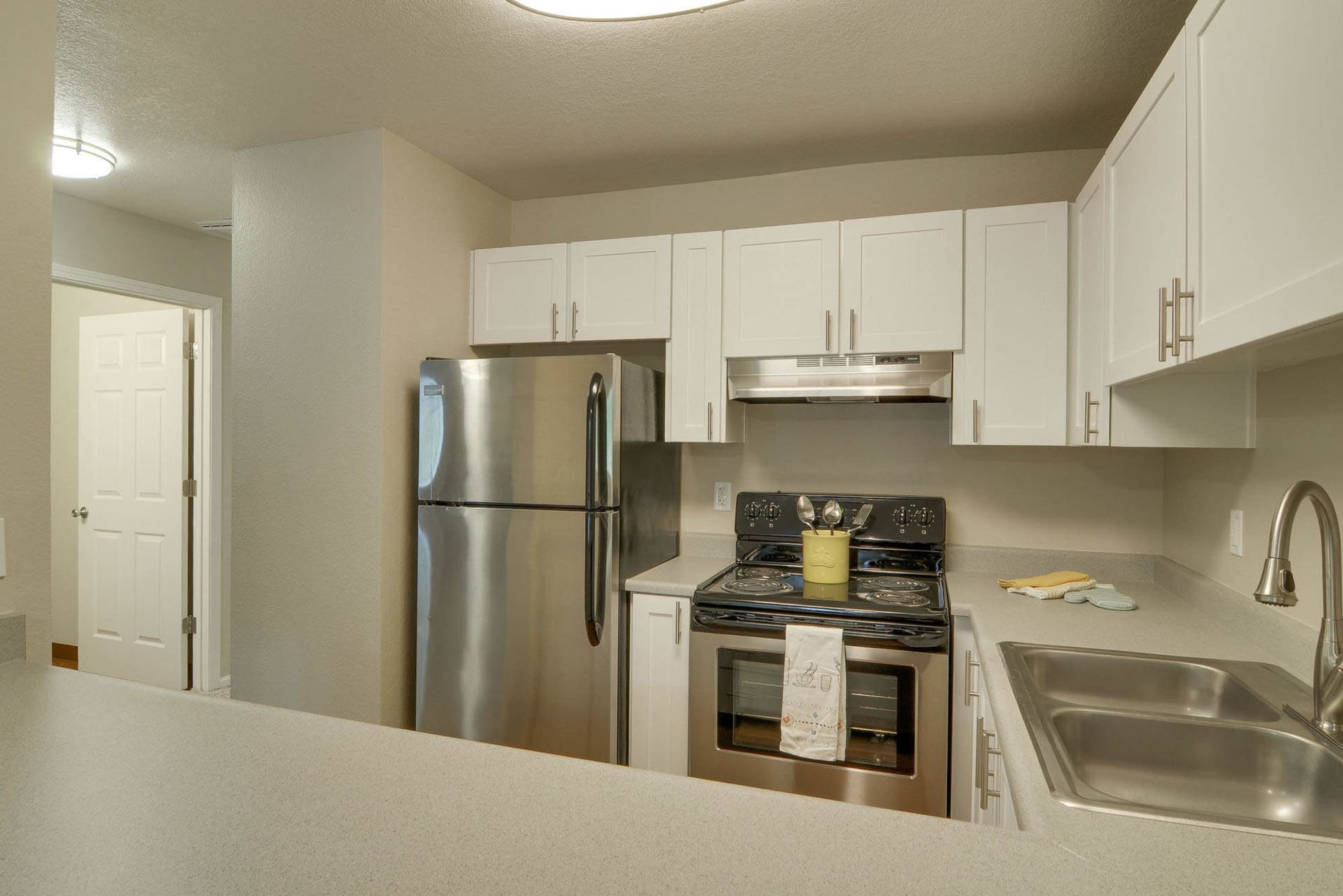 white renovated Kitchen at apartments in Vancouver