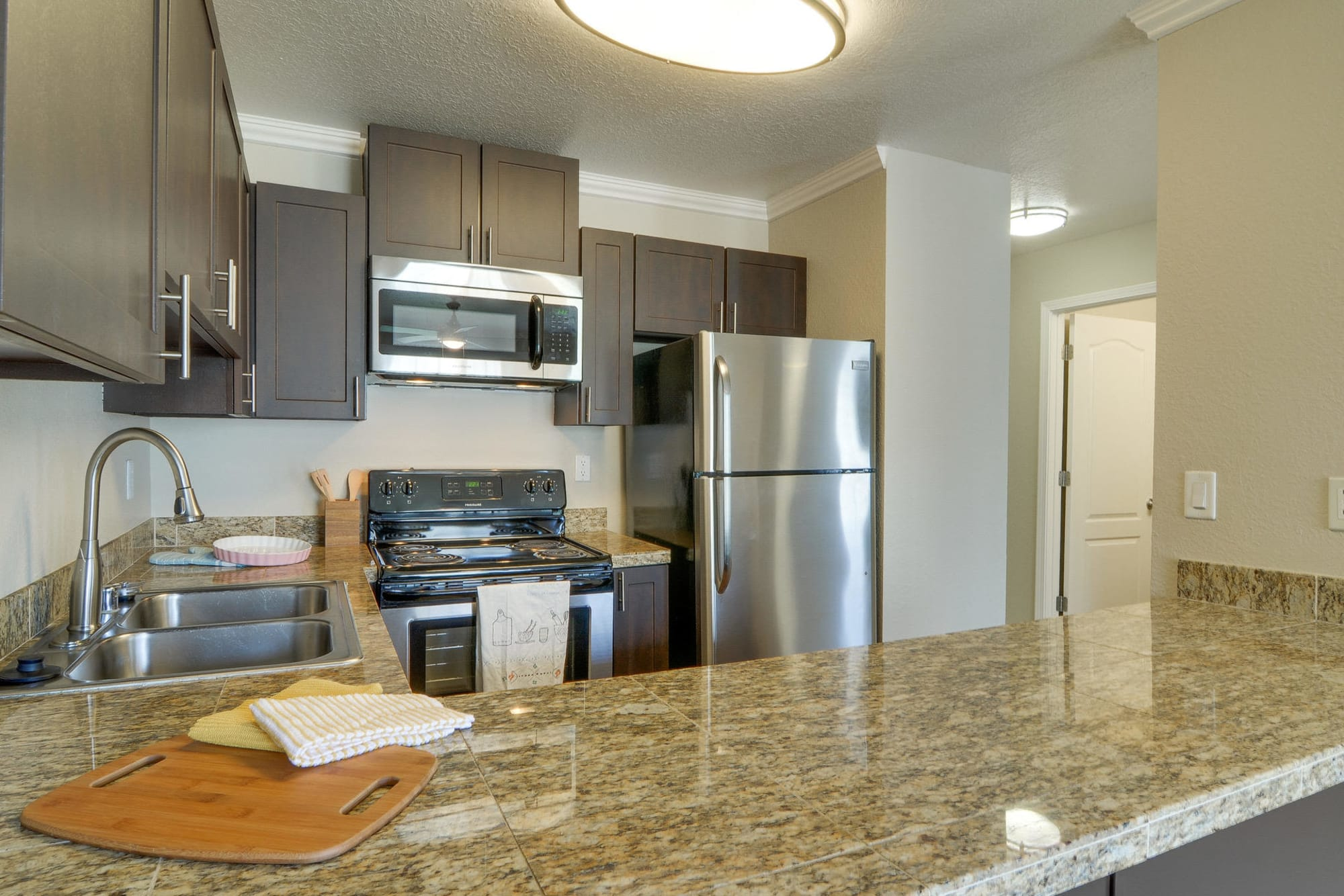 Granite countertops in kitchens at apartments in Carriage House Apartments