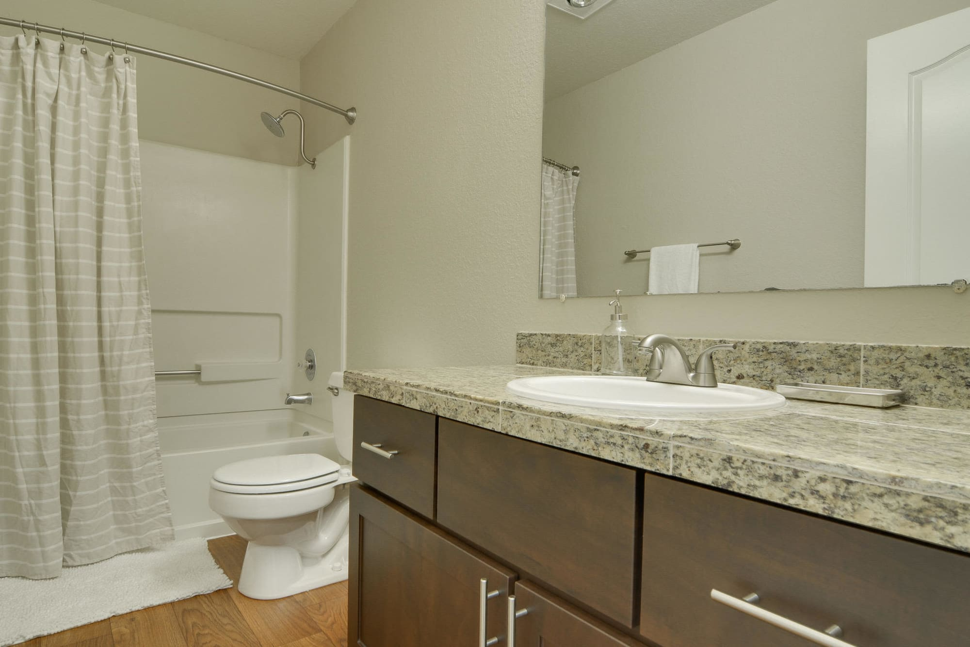 luxury apartment bathroom with tub at Carriage House Apartments in Vancouver, WA