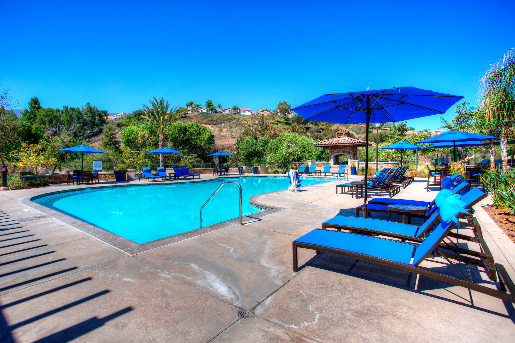resort-style Pool Deck with lounge chairs at Palisades Sierra Del Oro