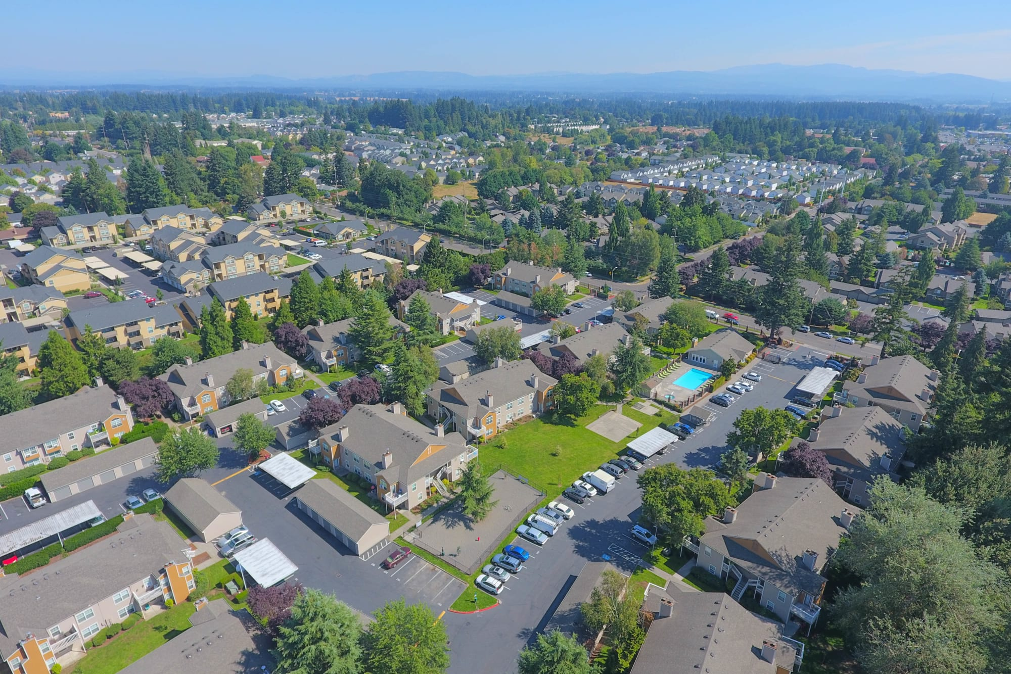An aerial view of the property and surrounding area at Carriage Park Apartments in Vancouver, Washington