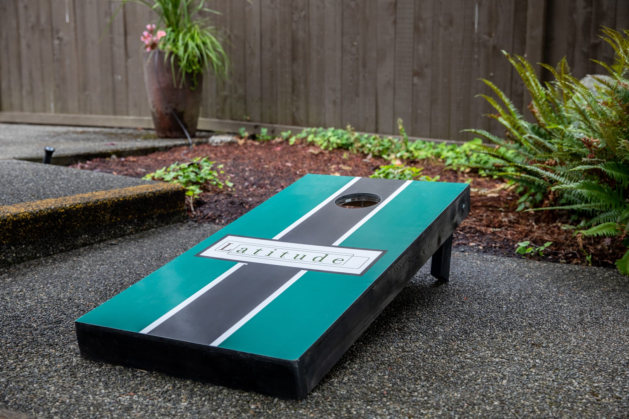 corn hole board in common area courtyard