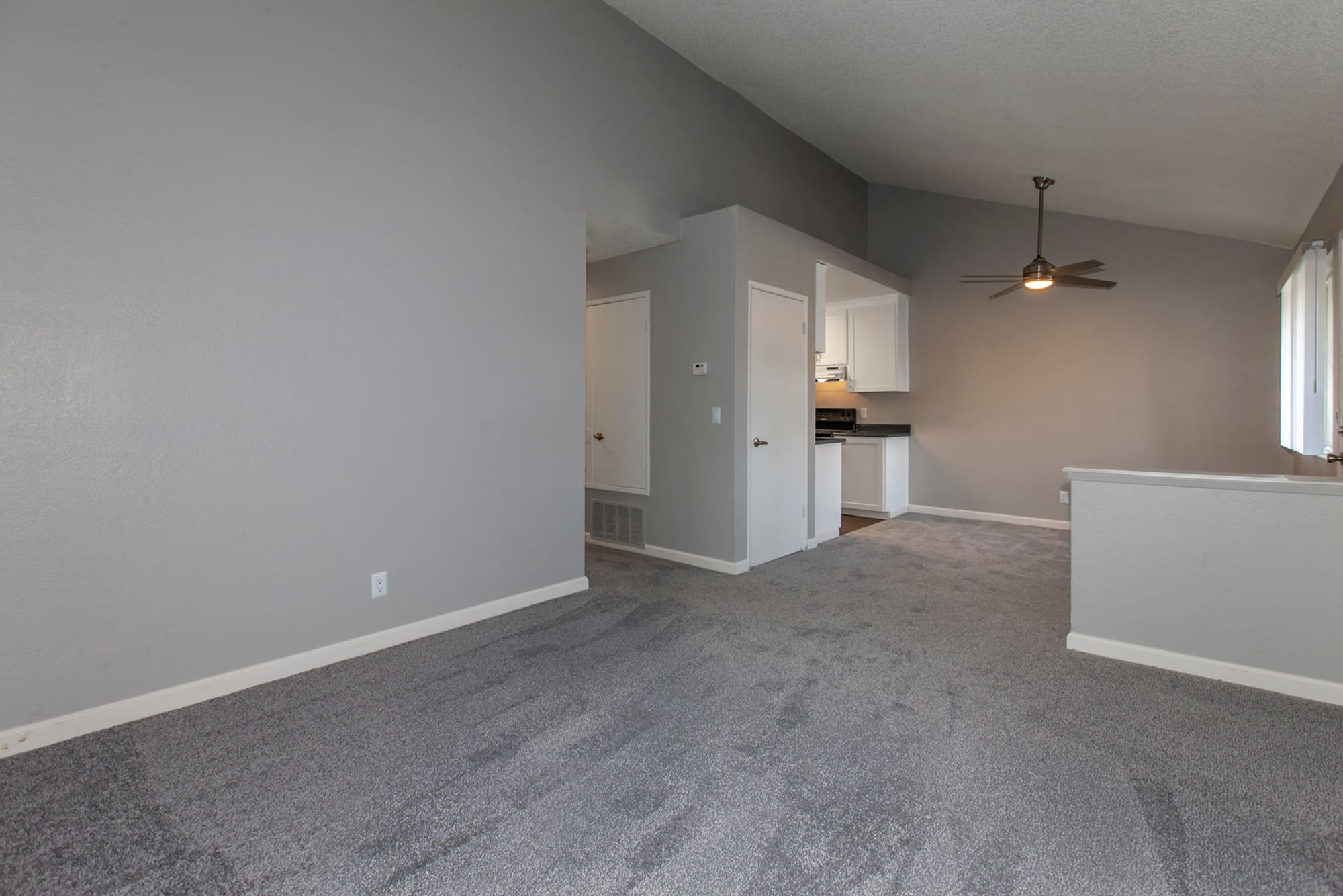 open newly renovated white spec living room