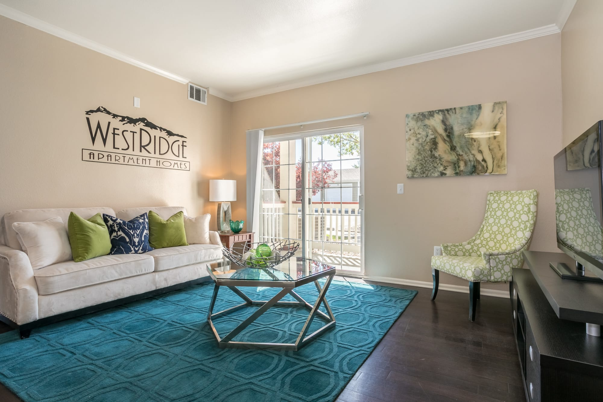 Well decorated living room at Westridge Apartments in Aurora, Colorado