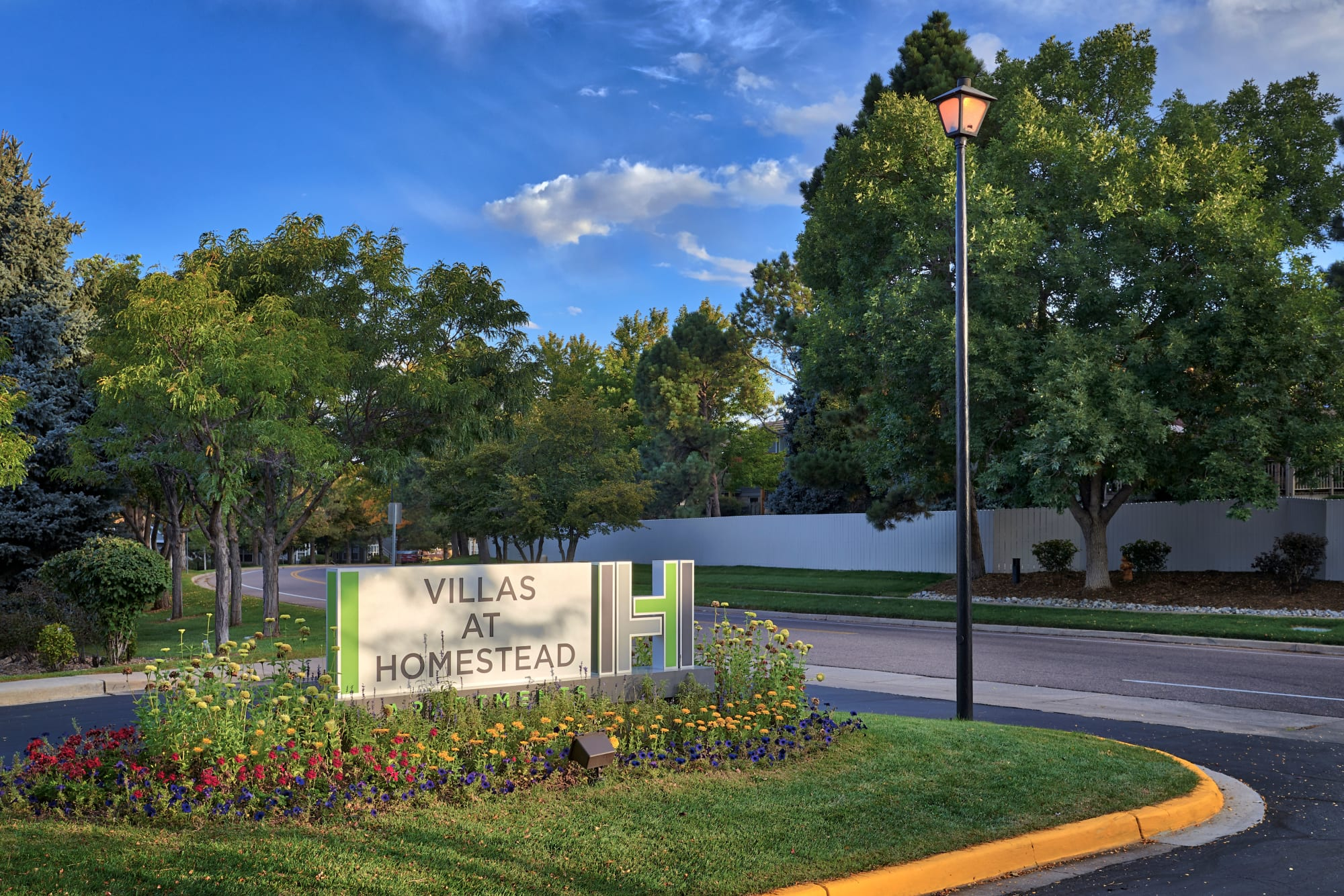 Monument sign at Villas at Homestead Apartments in Englewood, Colorado