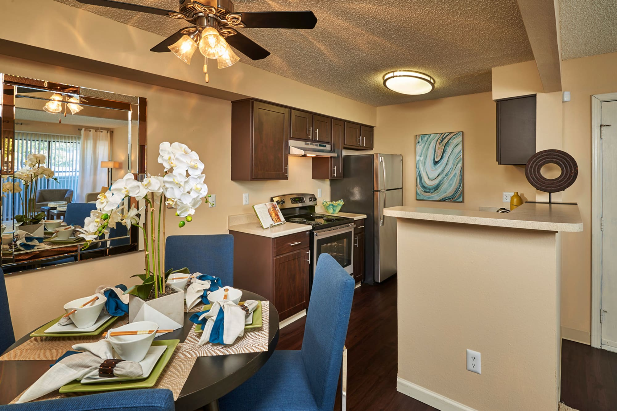 Kitchen Dining Room Combo - brown at Alton Green Apartments in Denver, CO