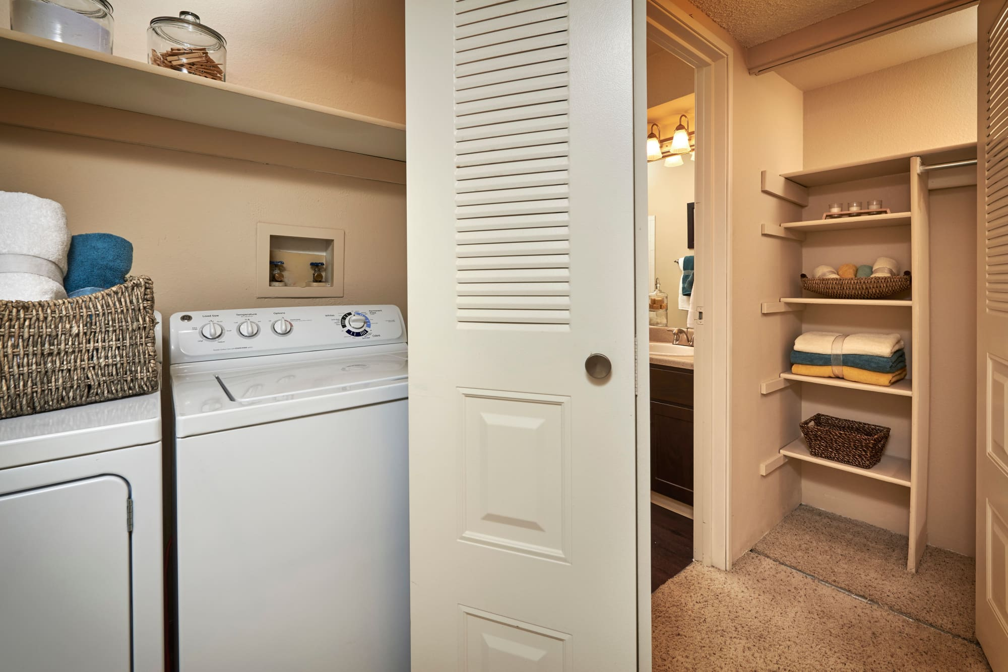 Washer And Dryer Machine at Alton Green Apartments in Denver, CO