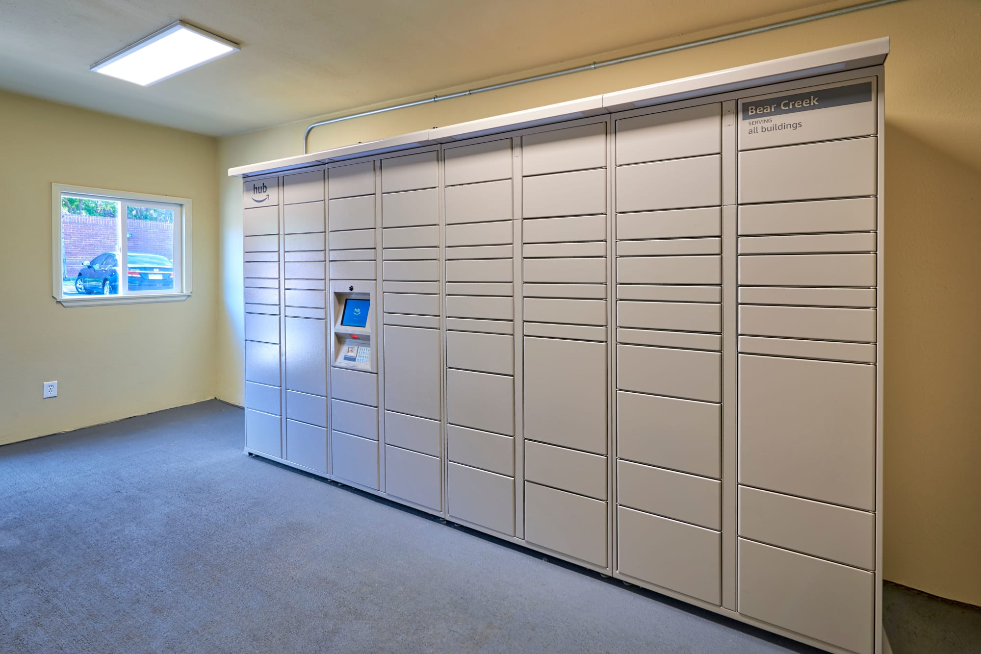 24-hour package locker room at The Crossings at Bear Creek Apartments in Lakewood, Colorado