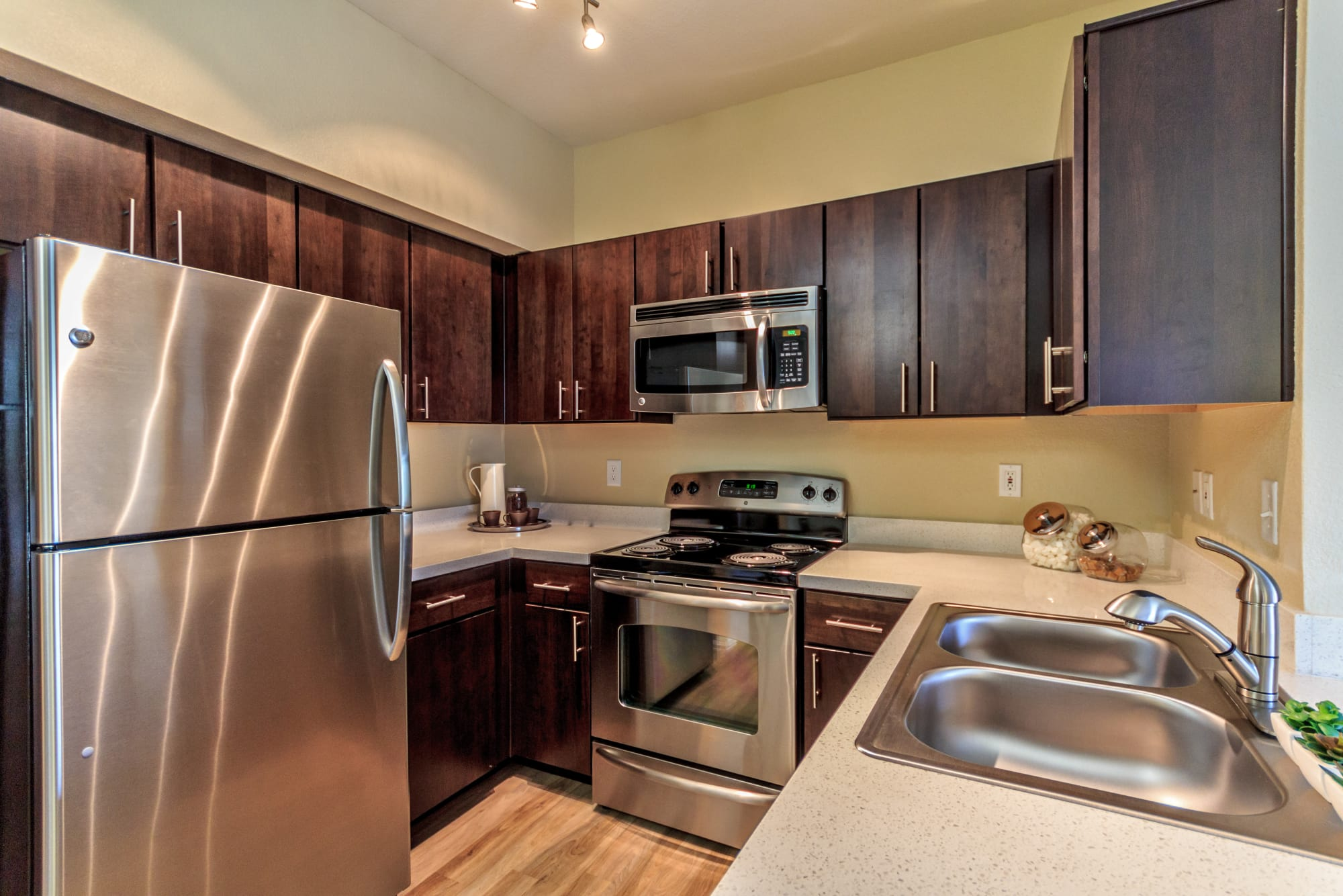 renovated brown kitchen with stainless steel appliances