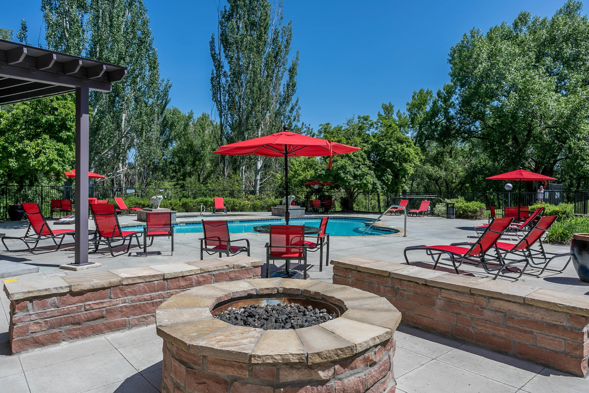 The poolside fire pit lounge area at The Crossings at Bear Creek Apartments in Lakewood, Colorado