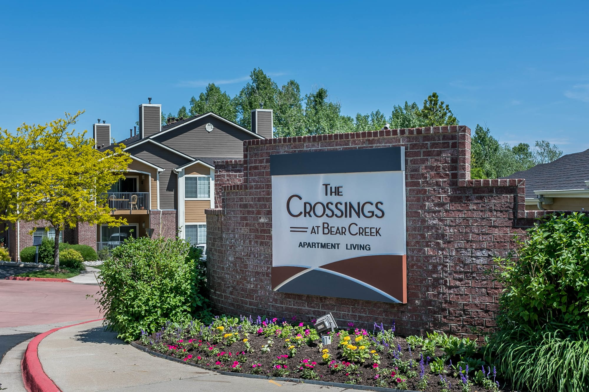 The monument sign at The Crossings at Bear Creek Apartments in Lakewood, Colorado