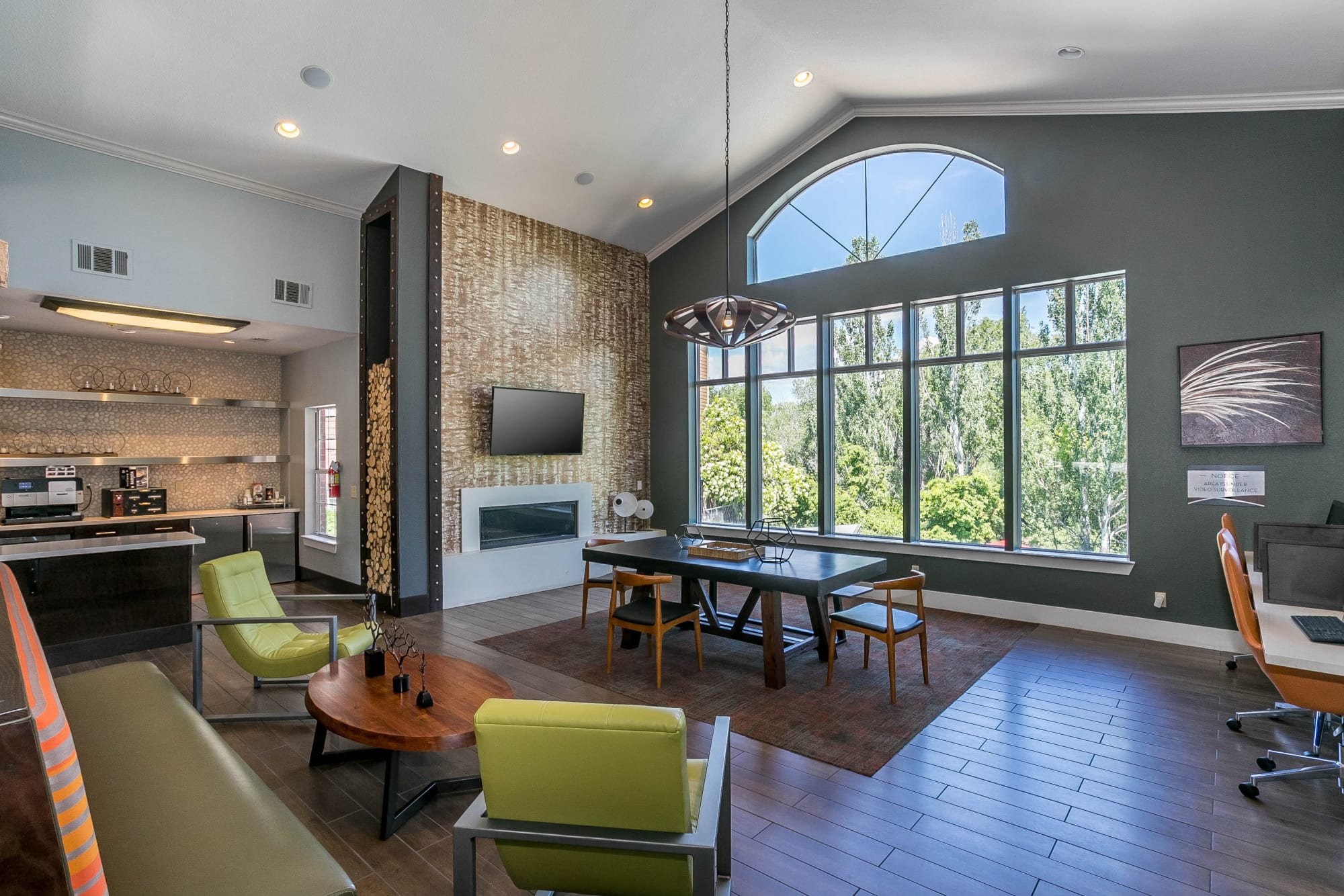 interior clubhouse lounge with conference table and fireplace