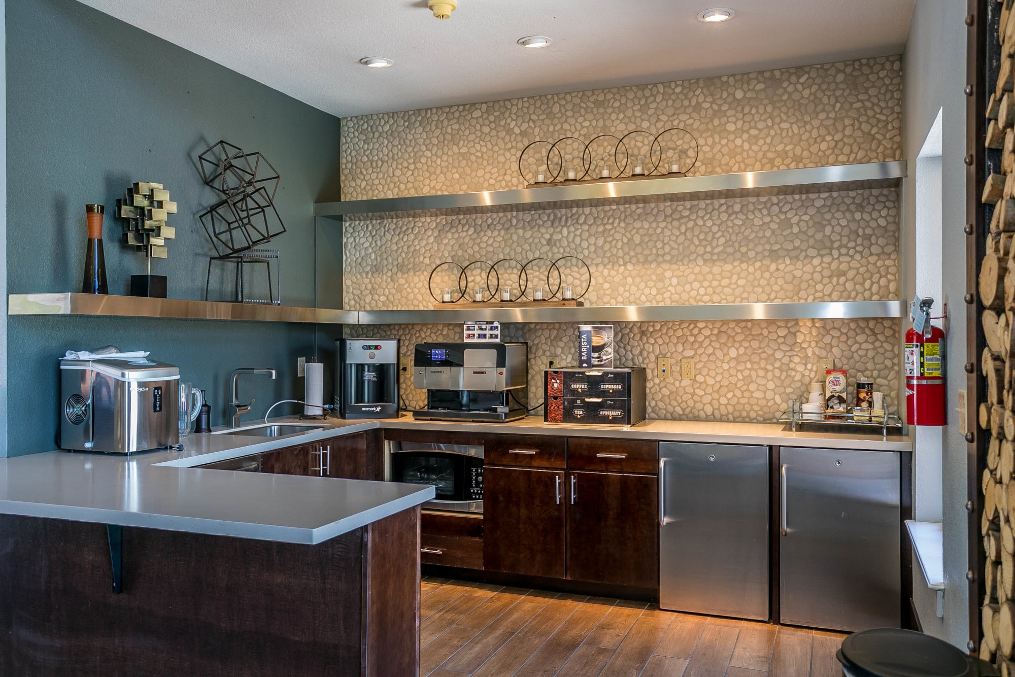 The clubhouse kitchen at The Crossings at Bear Creek Apartments in Lakewood, Colorado