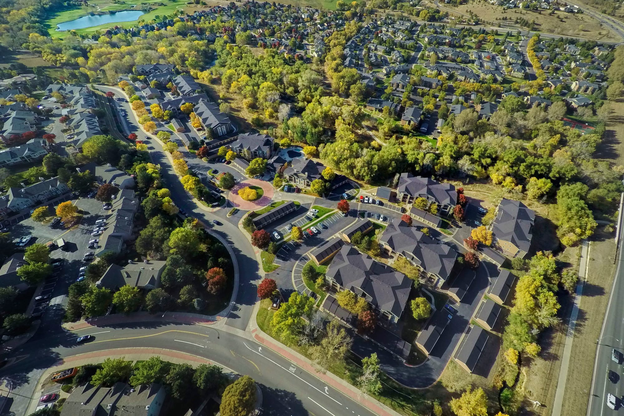 An aerial view of the property and surrounding areas at The Crossings at Bear Creek Apartments in Lakewood, Colorado