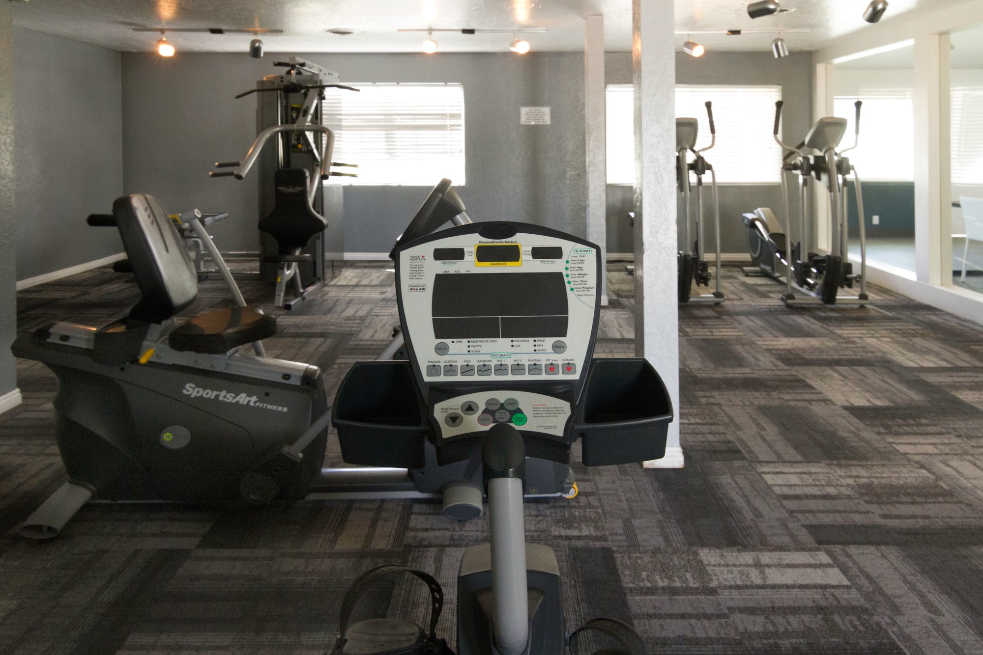 fitness center with cardio machines at Callaway Apartments in Taylorsville, UT